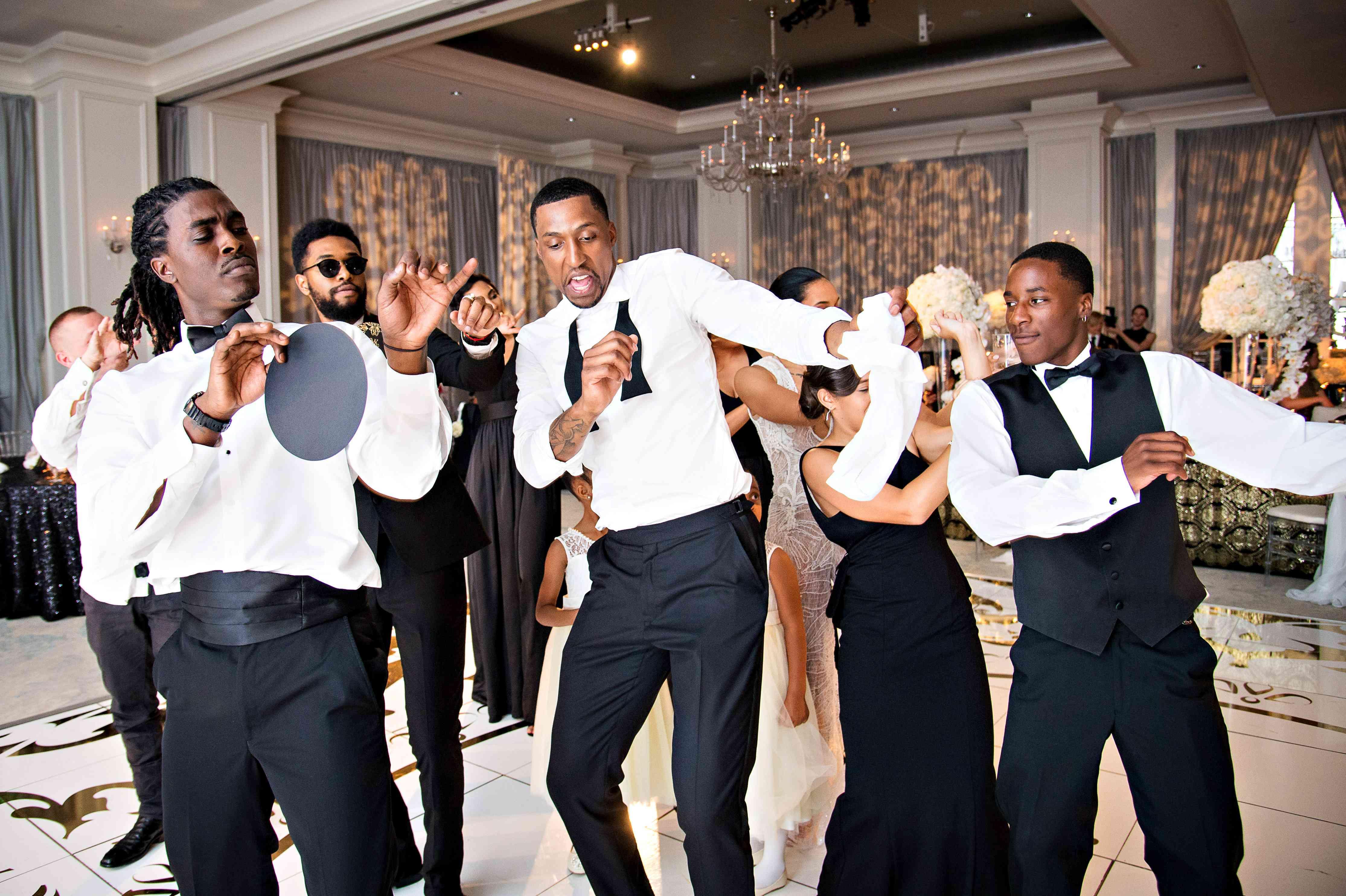 Groom dancing with groomsmen