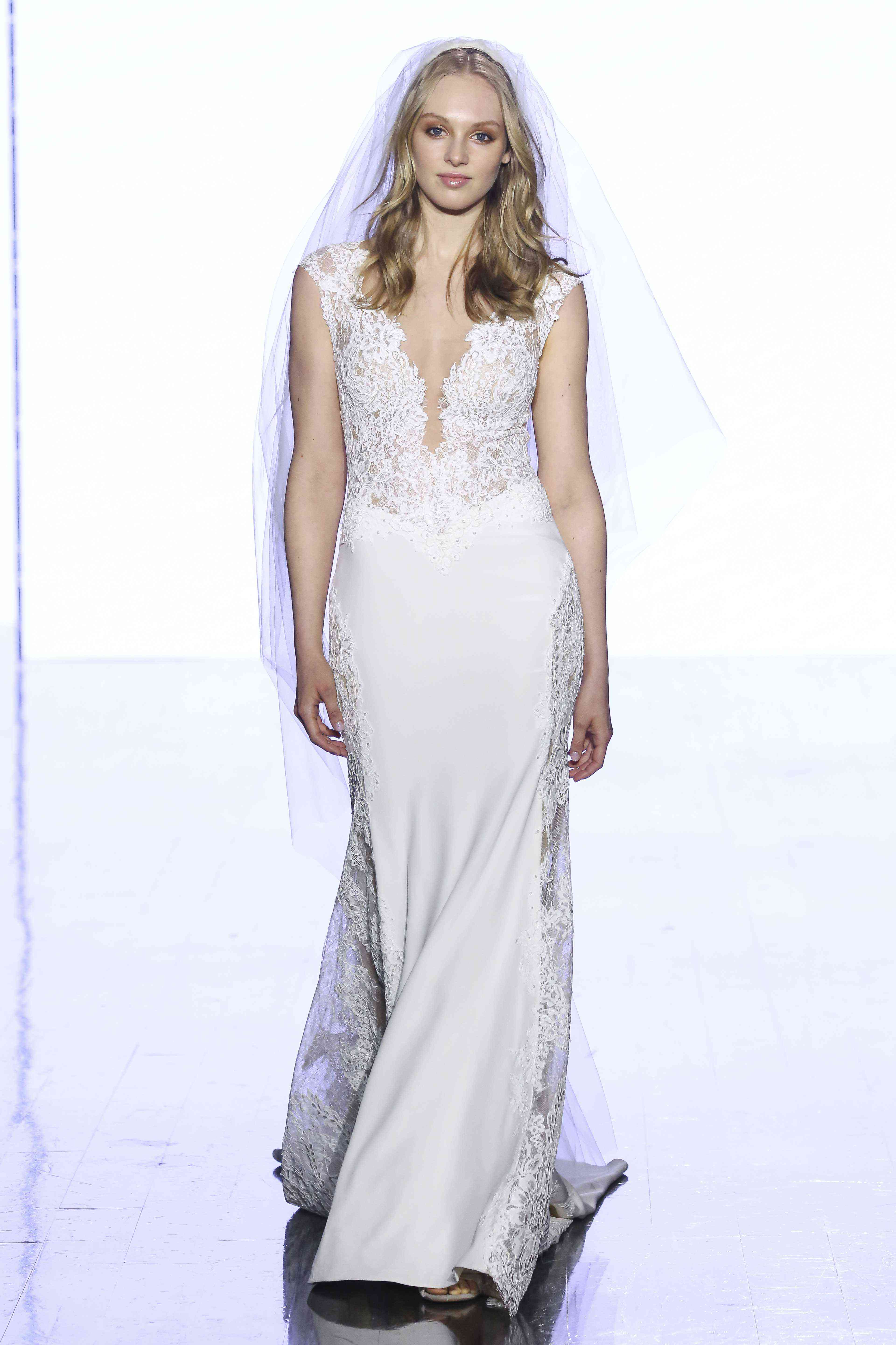 Model in lace and crepe sheath dress with plunging illusion neckline and cap sleeves