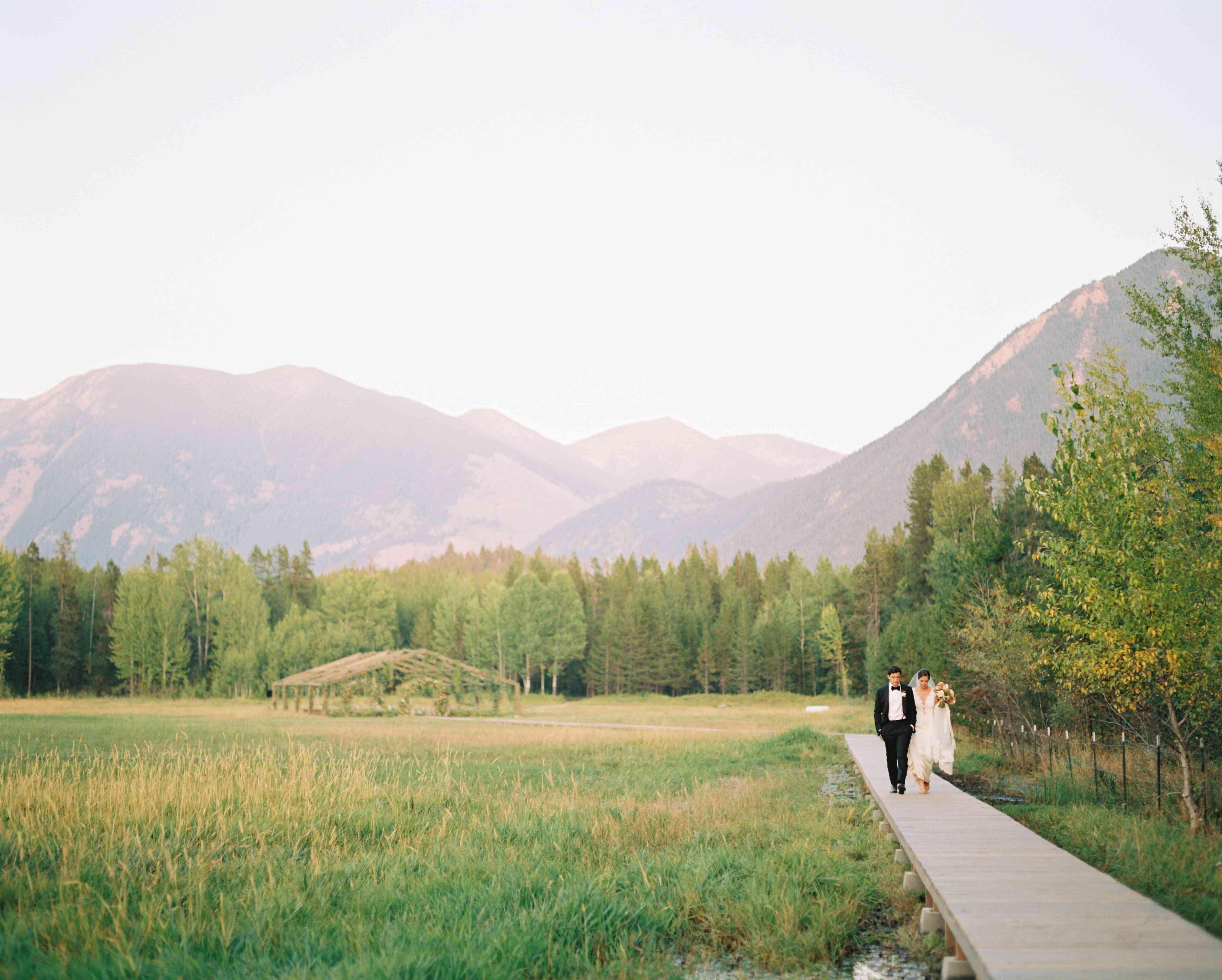 bride and groom on boardwalk
