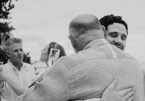 Groom and groom's father hugging