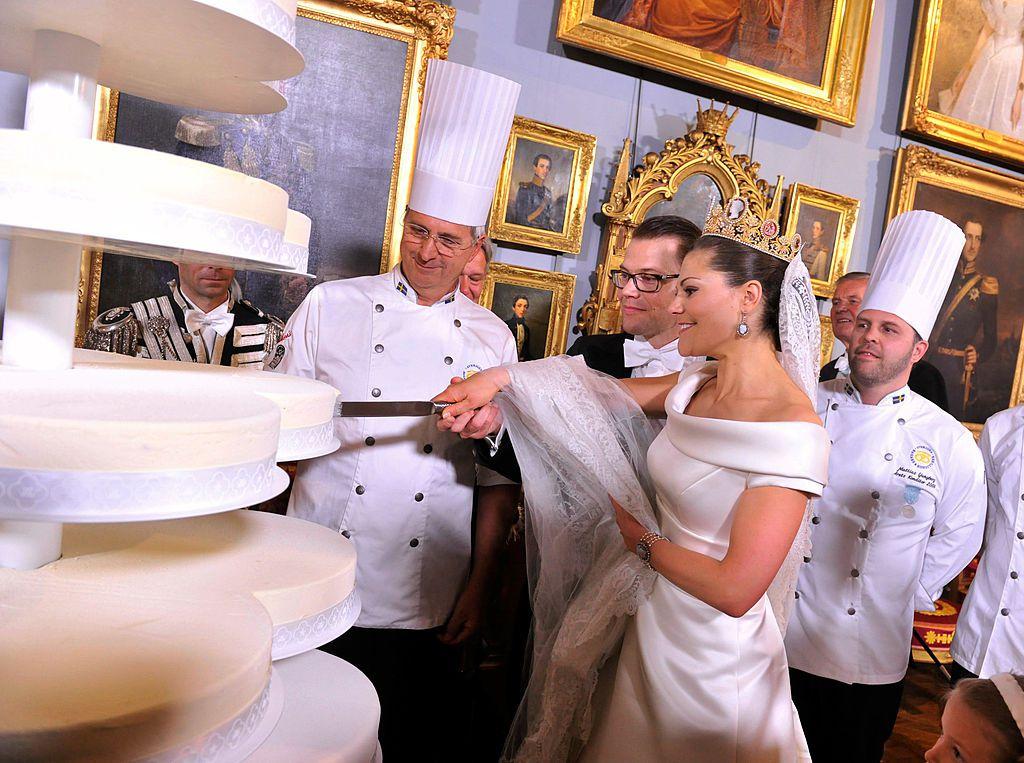 Princess Victoria of Sweden cutting wedding cake