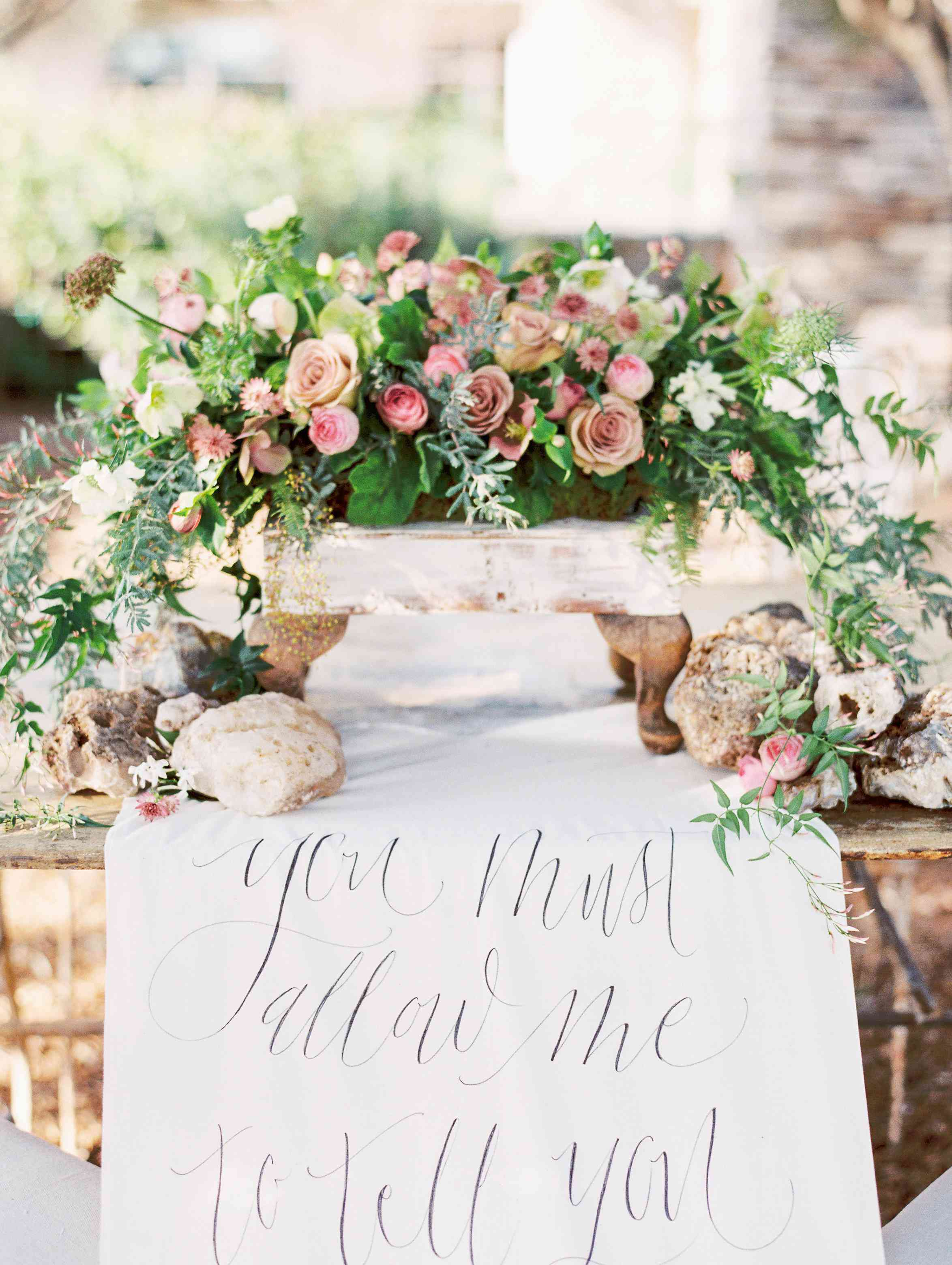 Flowers and table runner calligraphy sign.