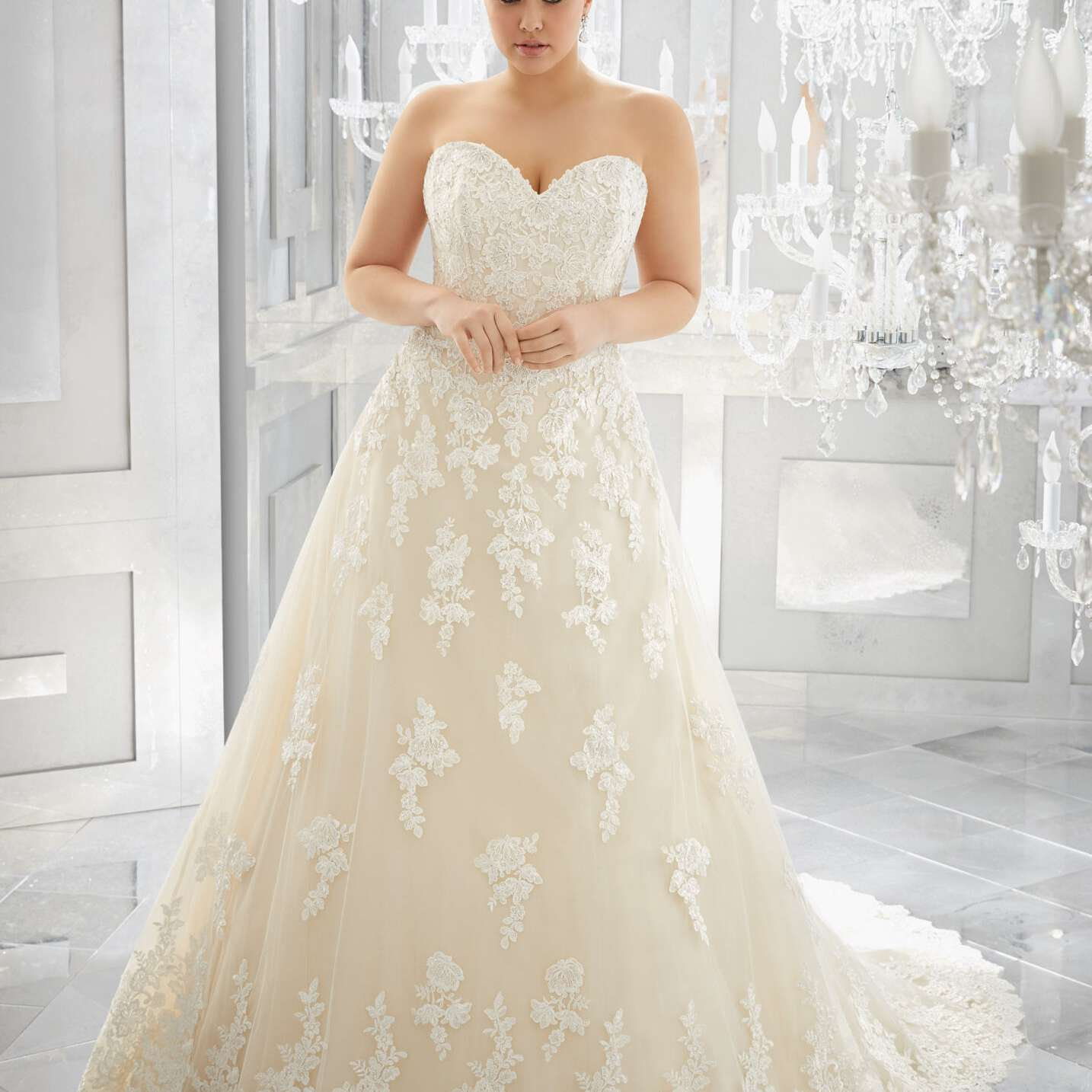 Plus size model in long strapless wedding gown with floral emroidery