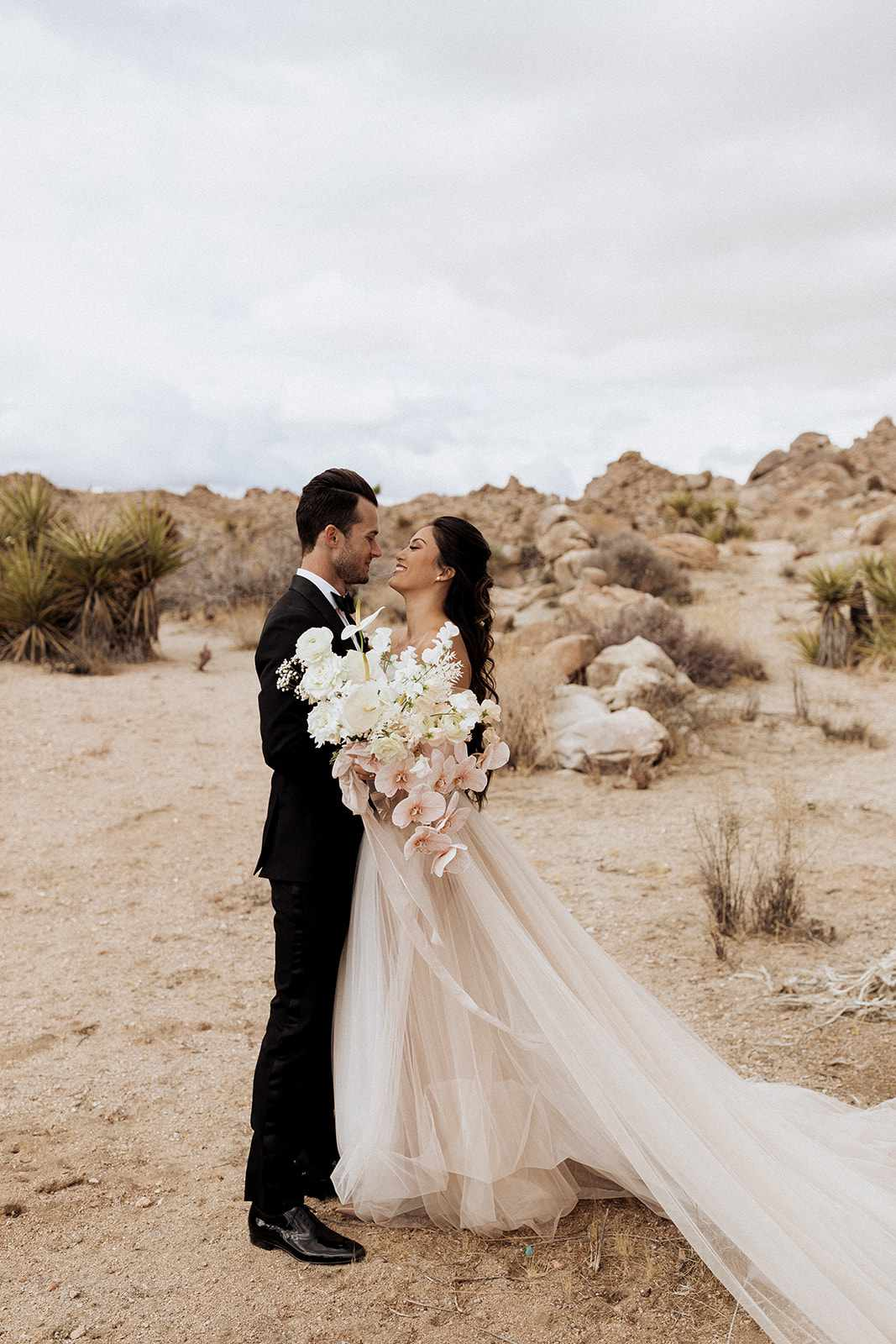 Couple with long stem bouquet