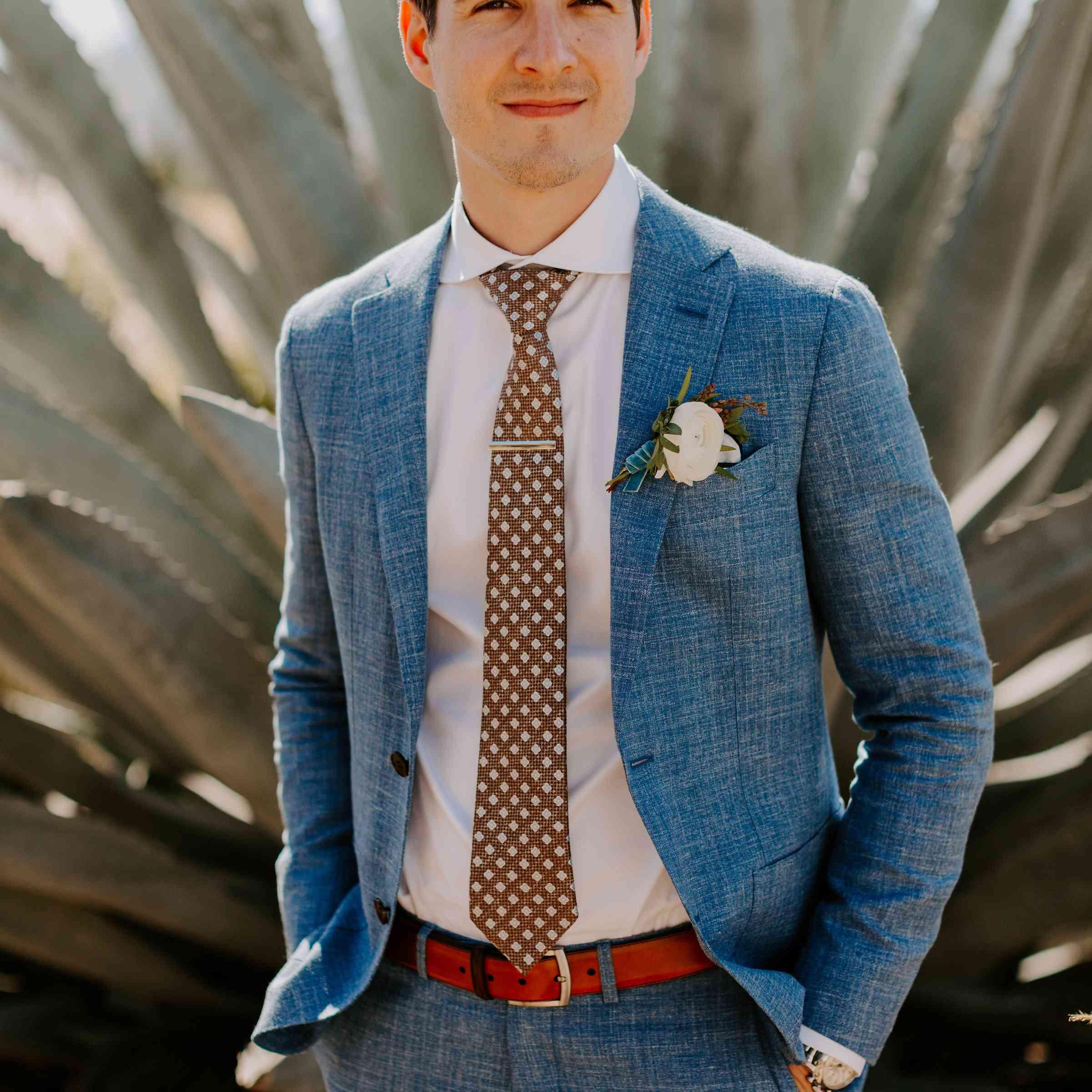 groom in blue linen suit
