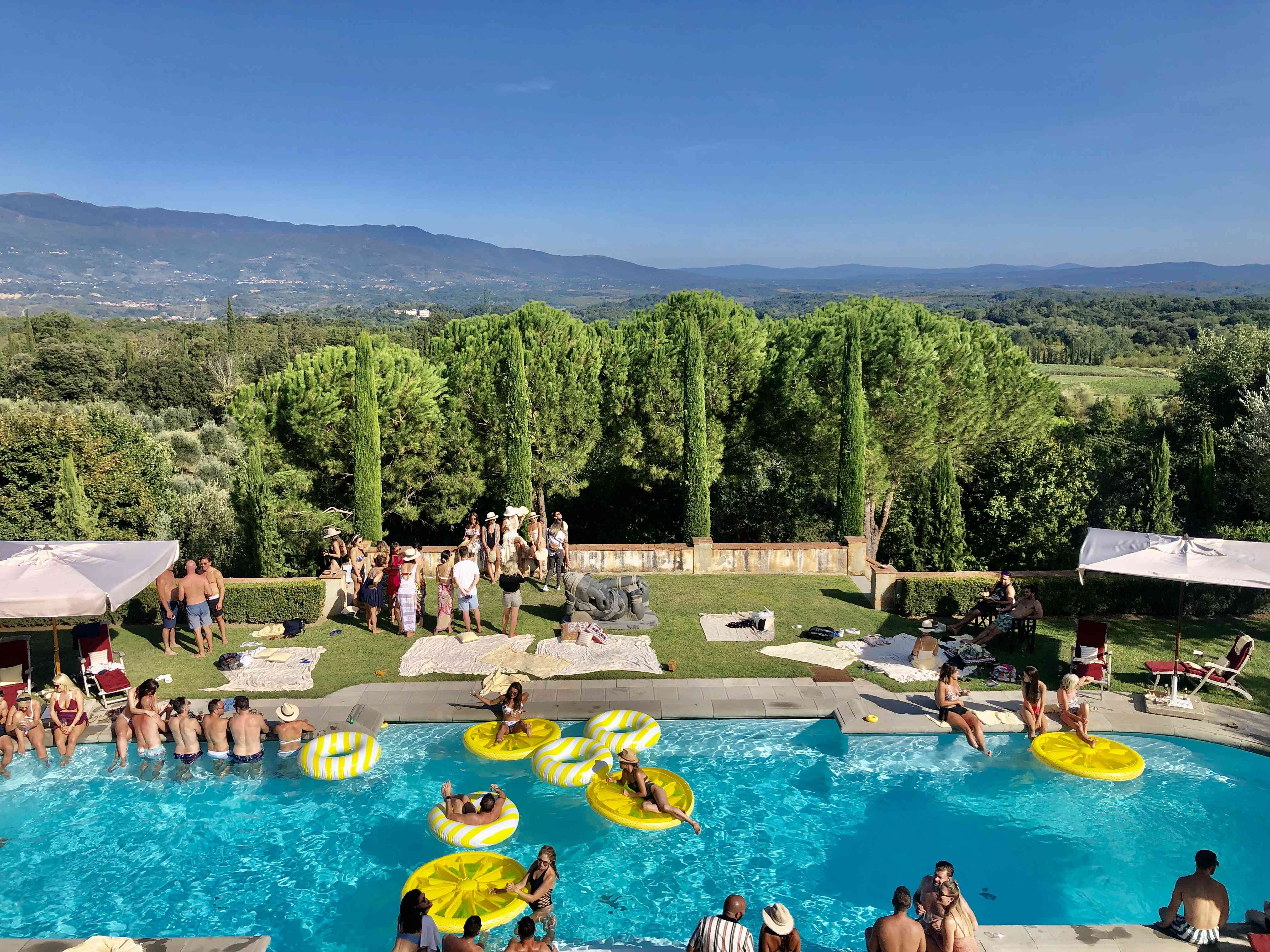 Aerial view of guests at a pool party