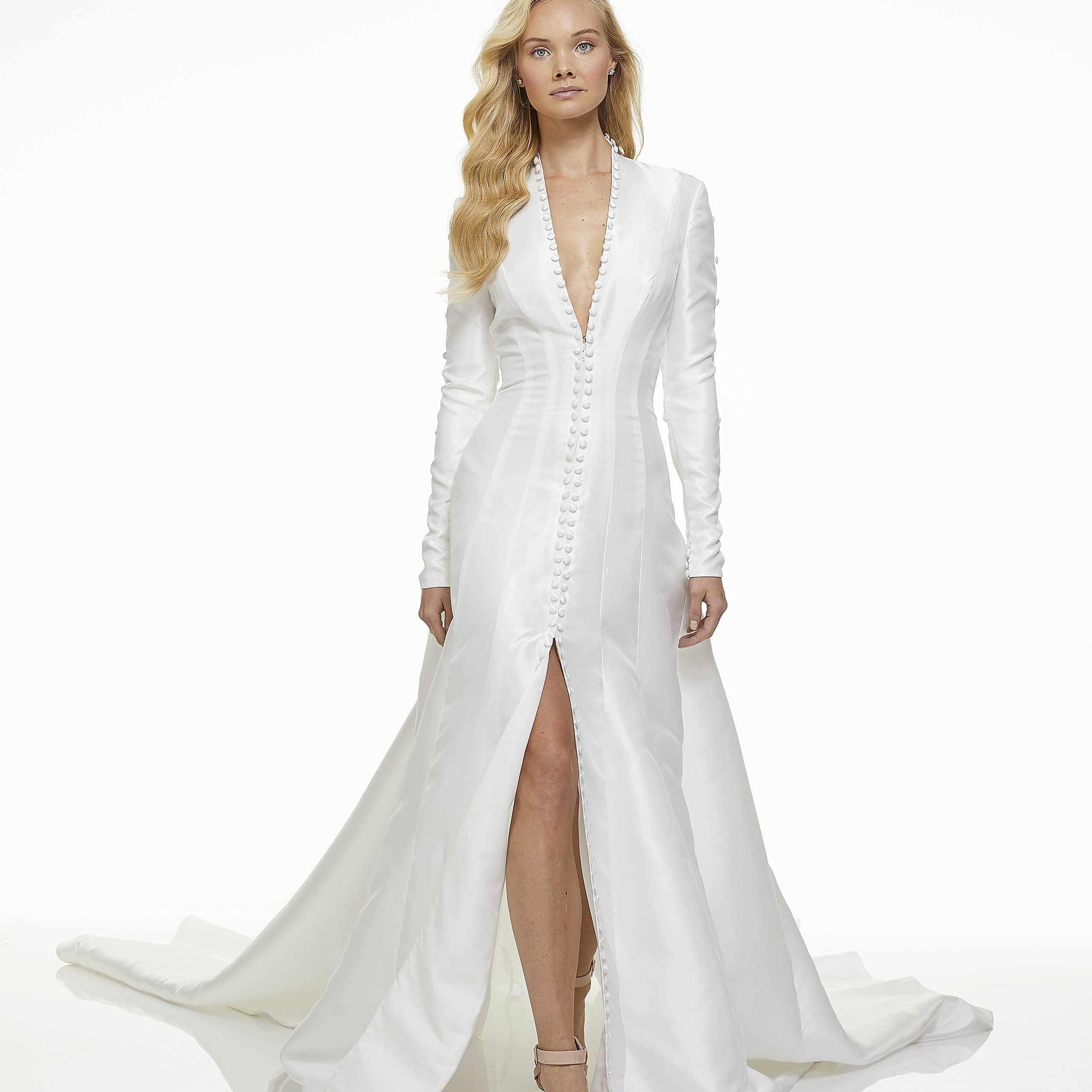 Model in long-sleeve A-line wedding dress