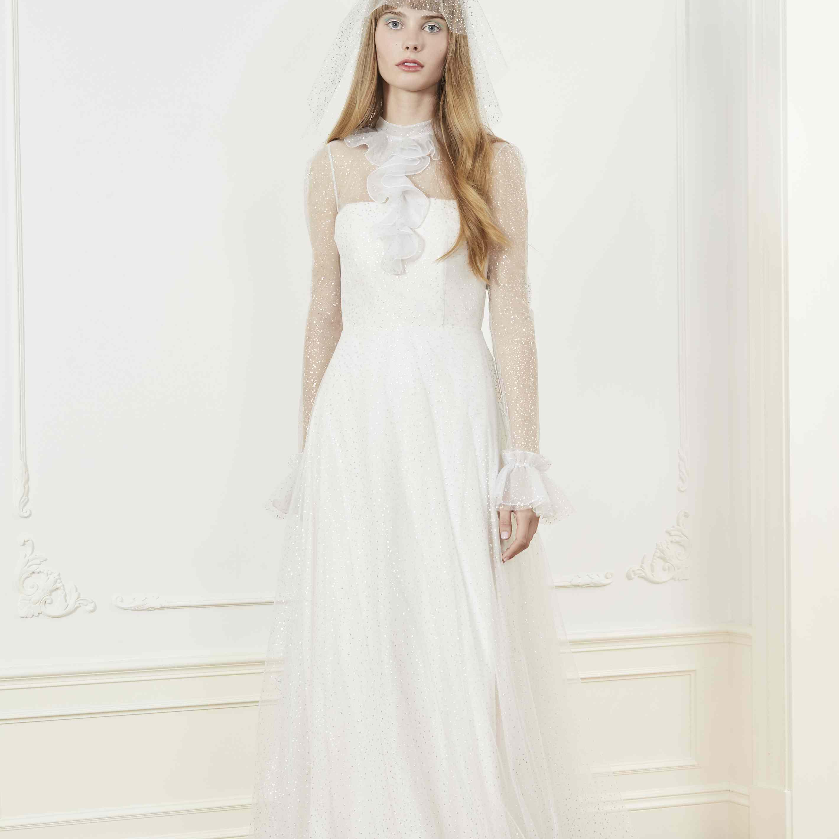 Model in long sleeve ruffle neckline wedding dress