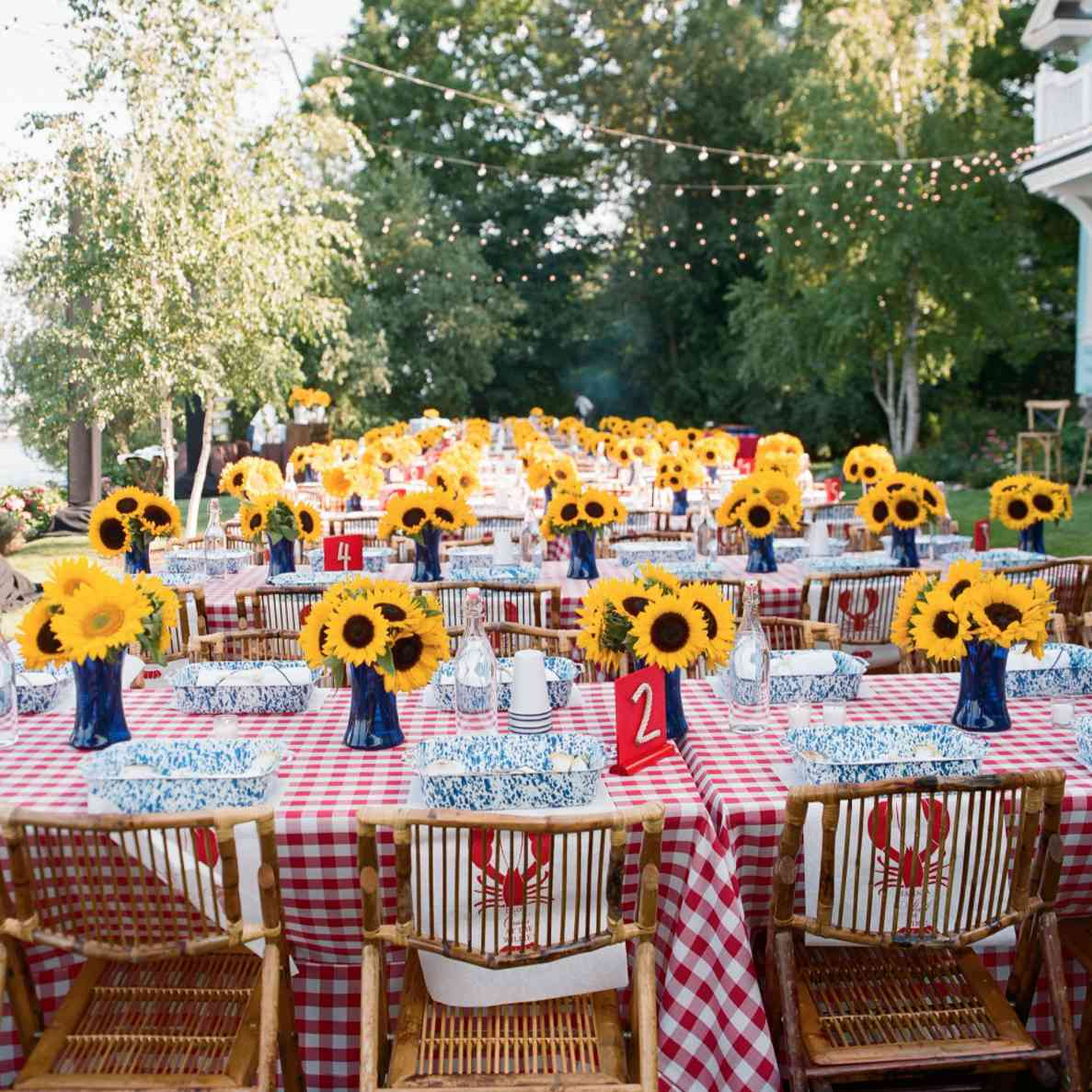 Sunflowers on checkered tablecloths for lobster bake reception