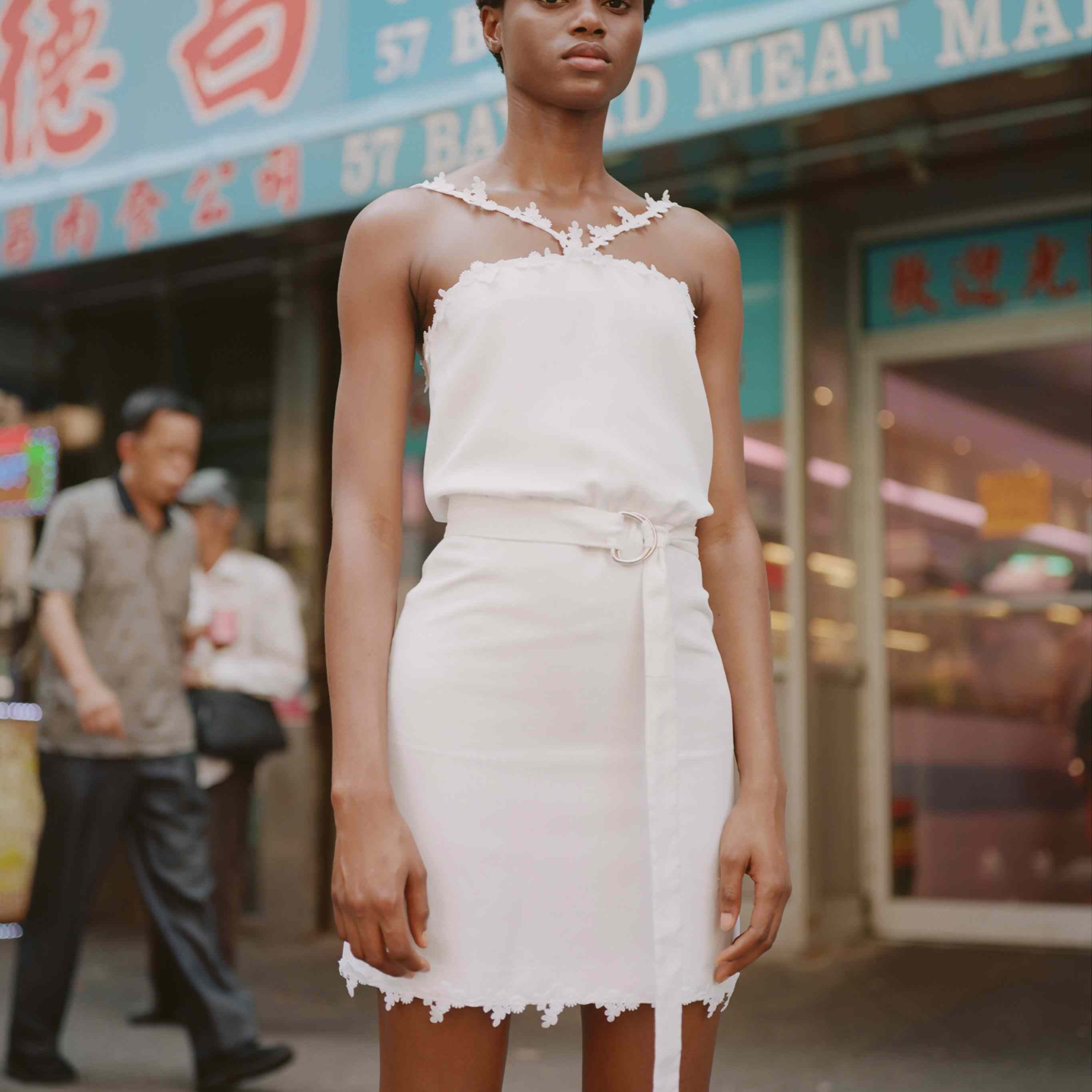 Model in halter mini wedding dress