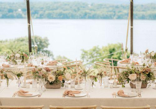 Blush reception overlooking lake
