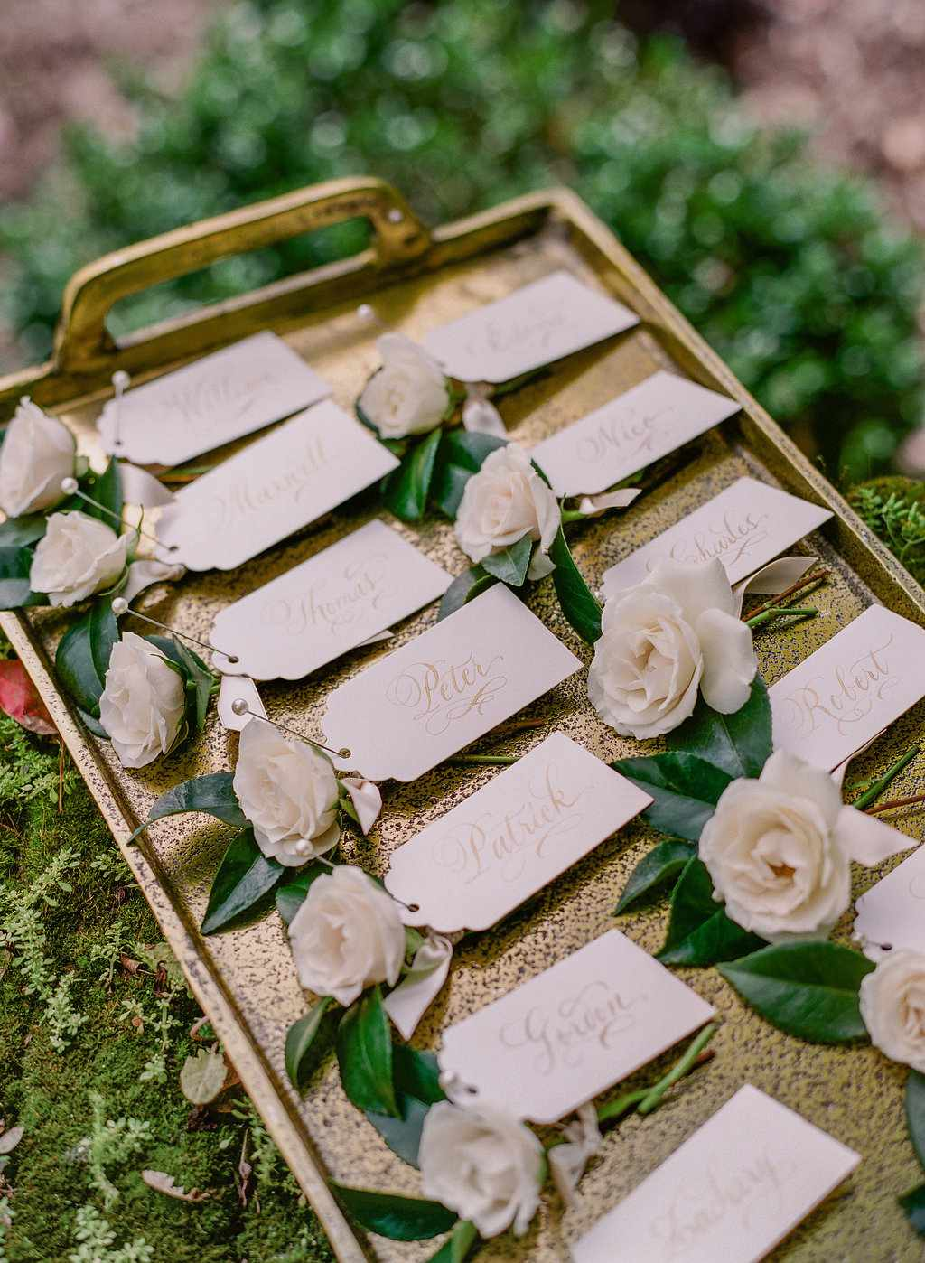 White rose boutonnieres with name cards