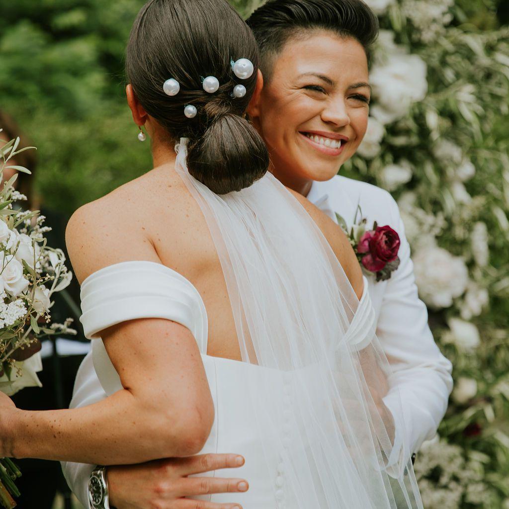 The brides hug