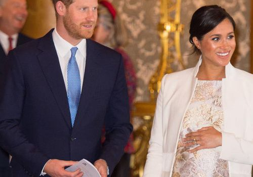 Meghan, Duchess of Sussex and Prince Harry, Duke of Sussex attend a reception to mark the fiftieth anniversary of the investiture of the Prince of Wales at Buckingham Palace.