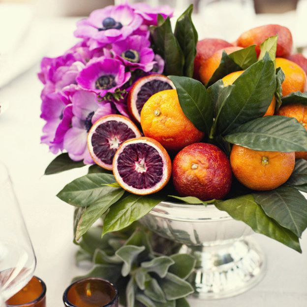 Blood oranges and flowers in a centerpiece