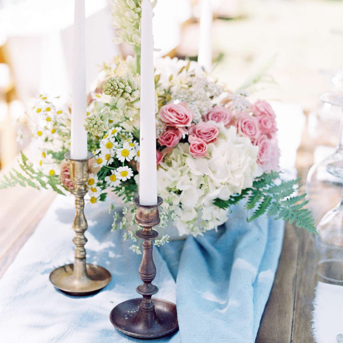 light blue table runner candles flowers
