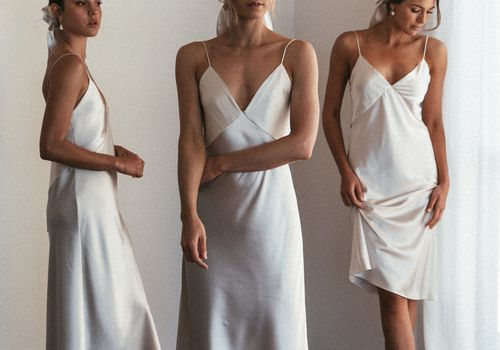 models wearing white dresses