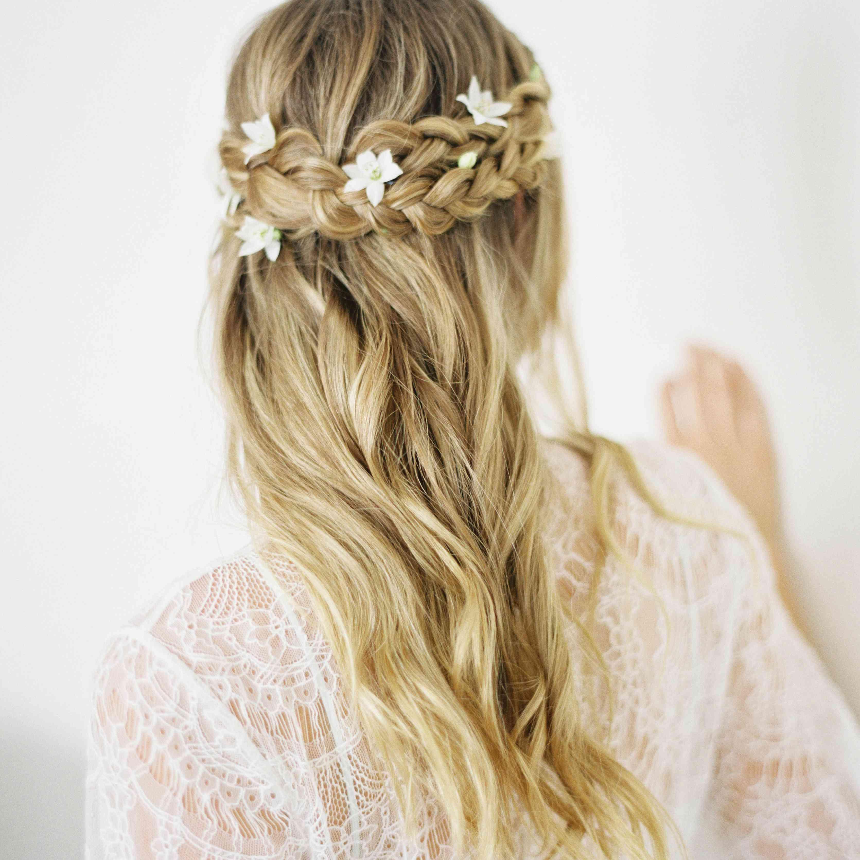 braided half up half down curly wedding hair