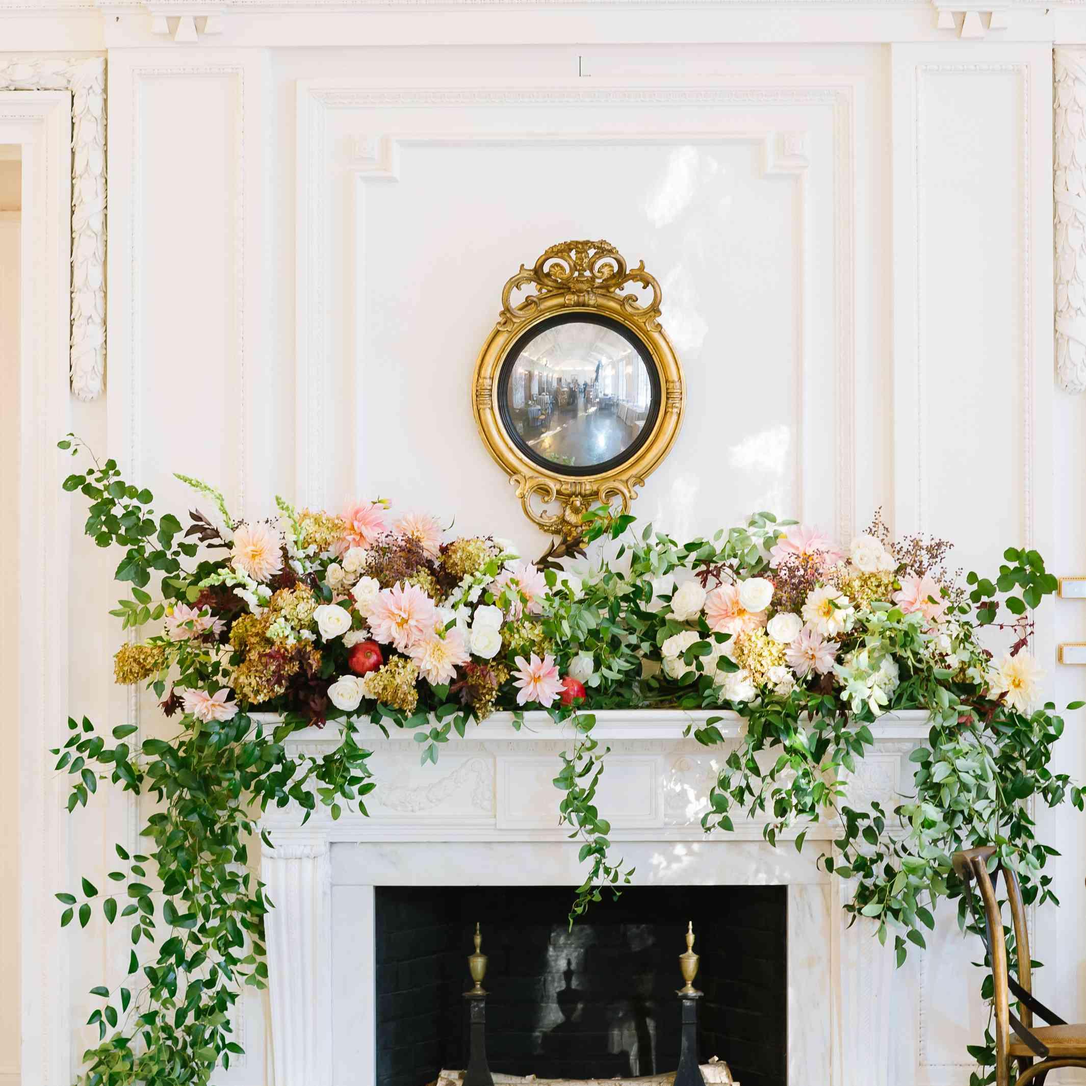 Bountiful floral arrangement on fireplace