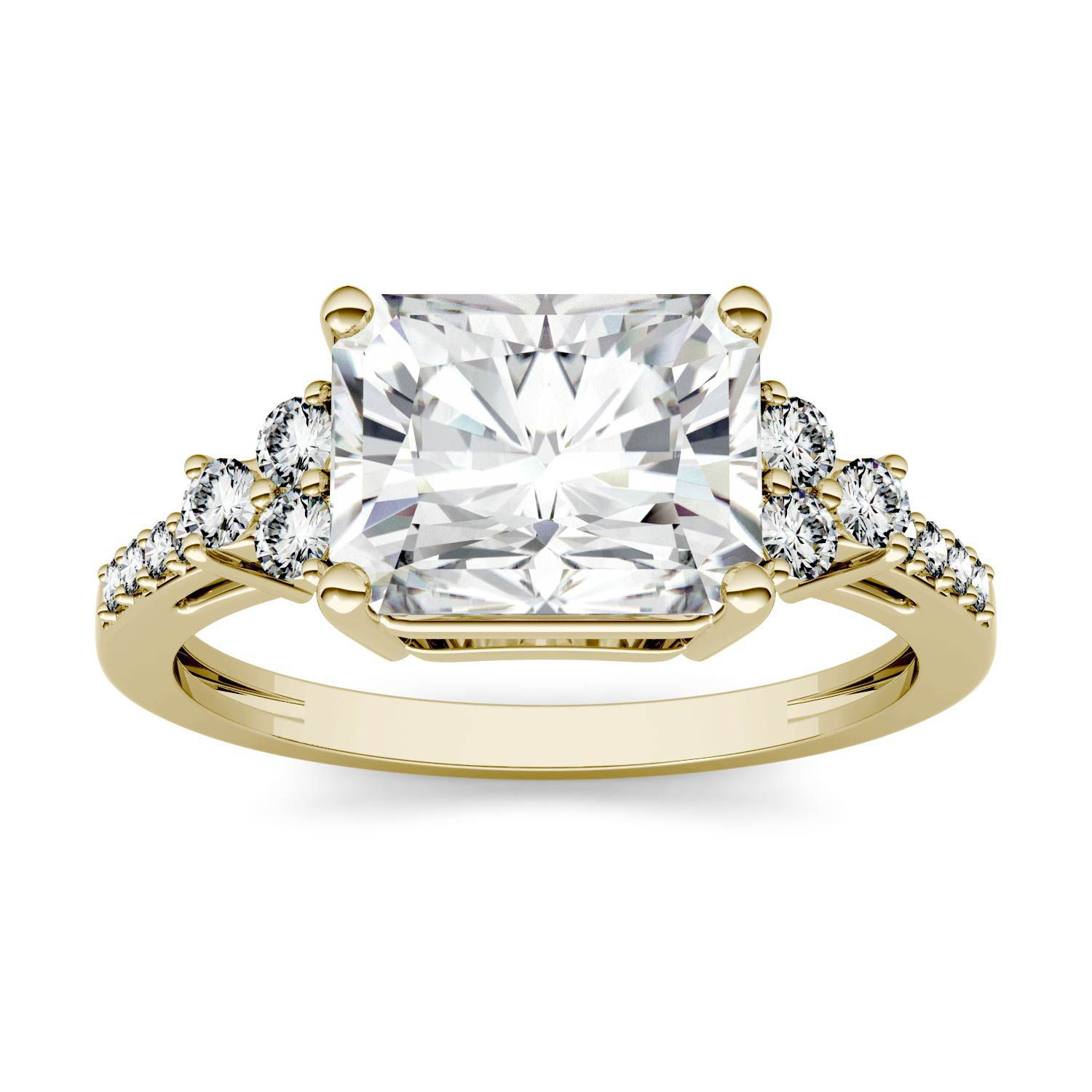 Radiant-cut diamond engagement ring with yellow gold band on a white background.