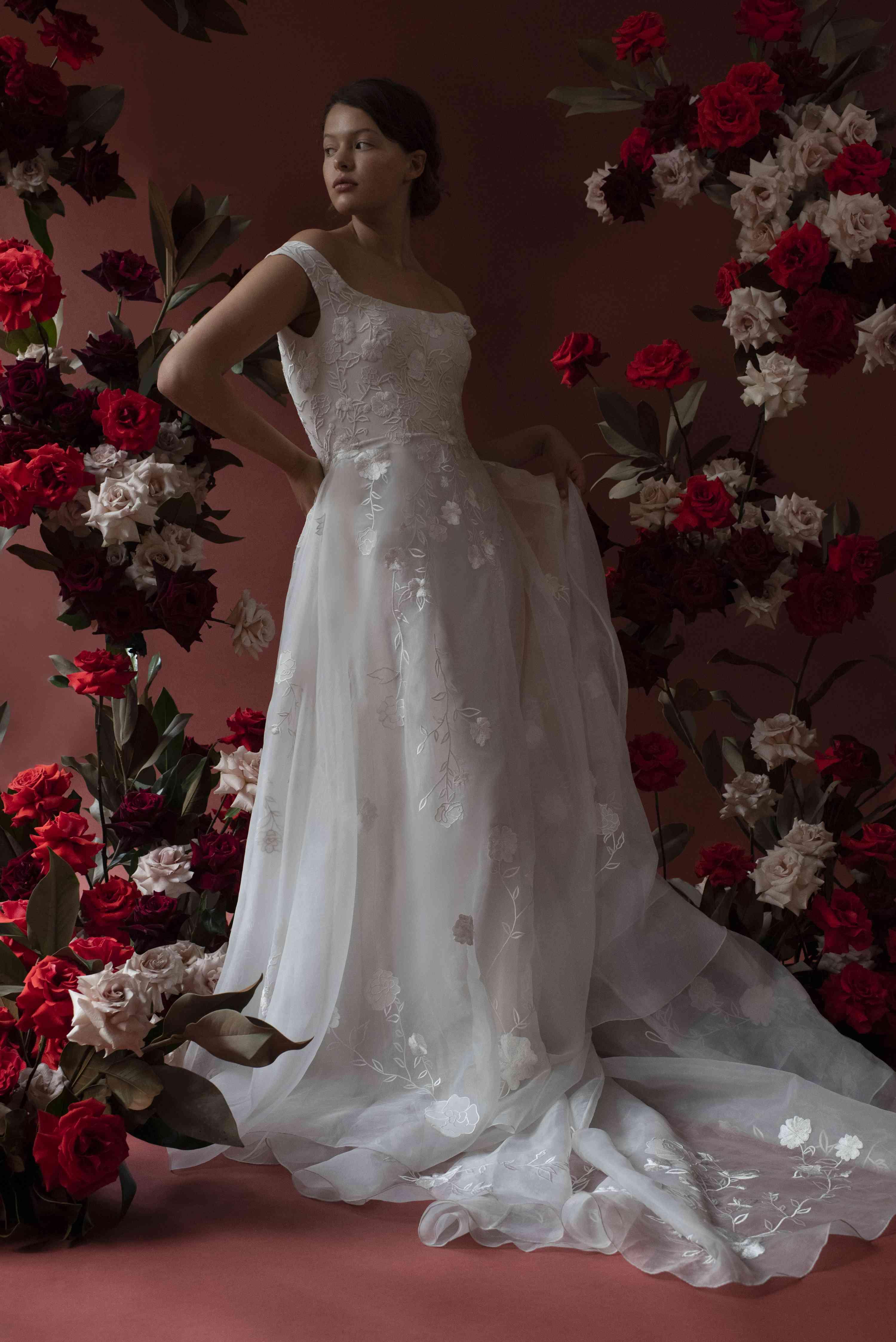 Model in sleeveless organza wedding dress