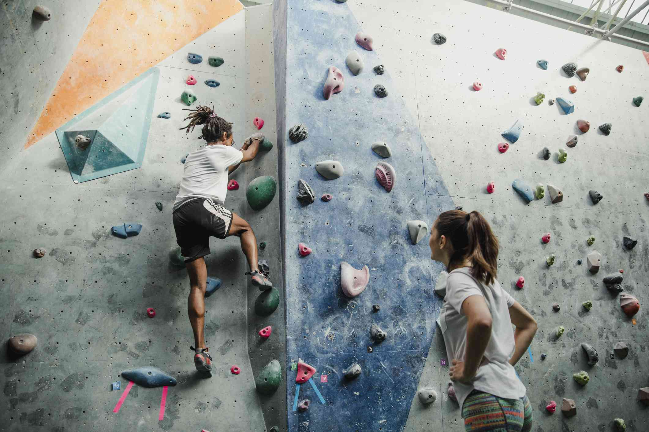 Young couple on indoor climbing wall