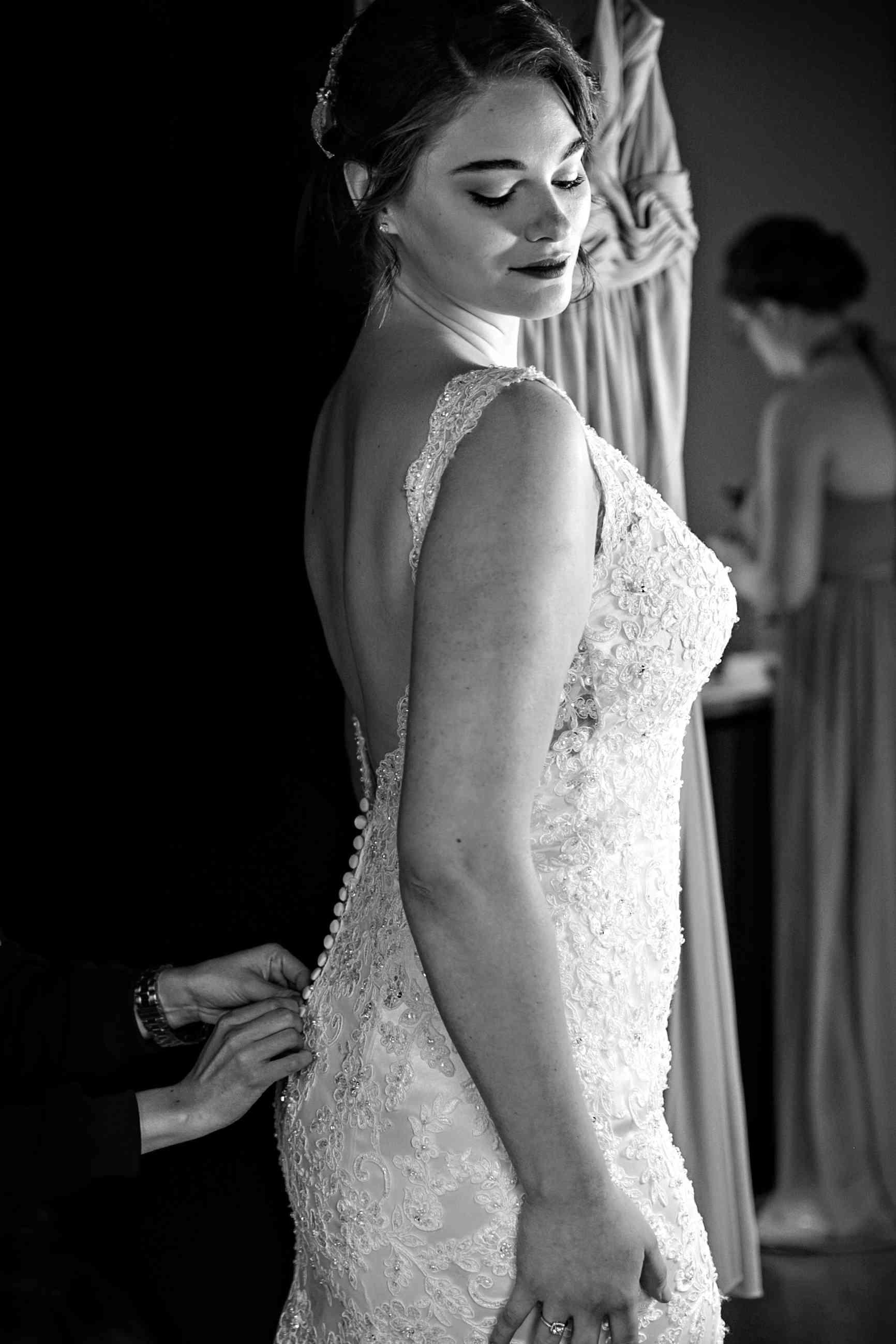 Jennie Runk putting on her wedding gown