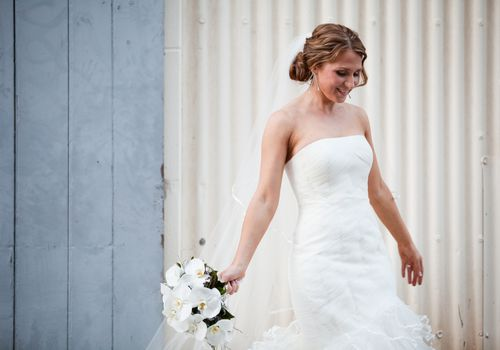 Bride in strapless gown with bouquet