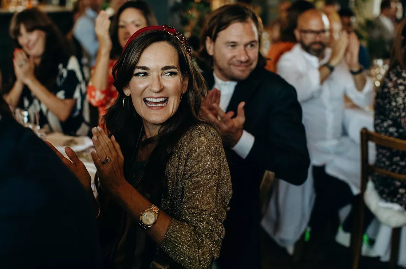 Wedding guest smiling and clapping