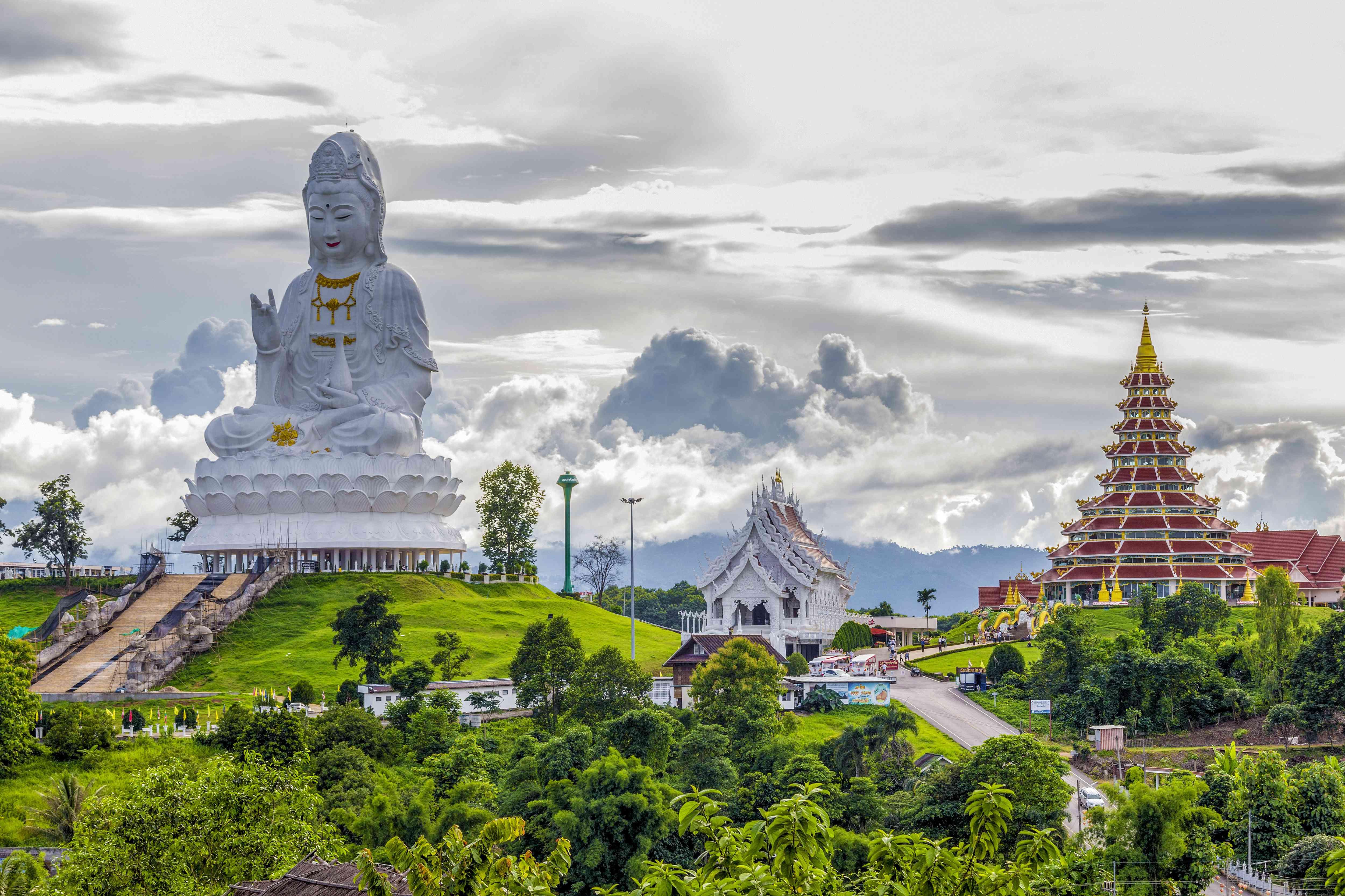 A temple and white Buddha statue in Chiang Rai, Thailand