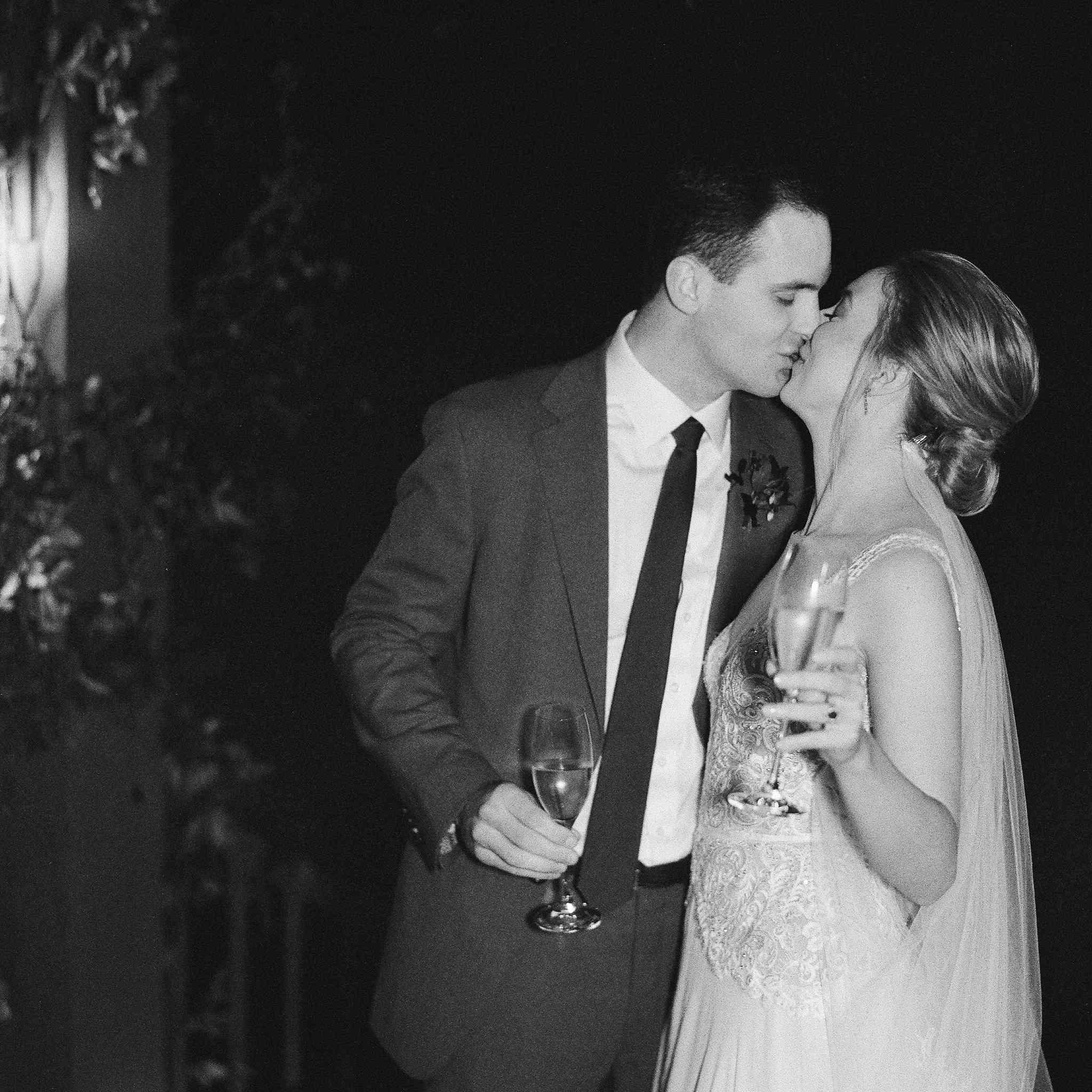 toast bride and groom kissing