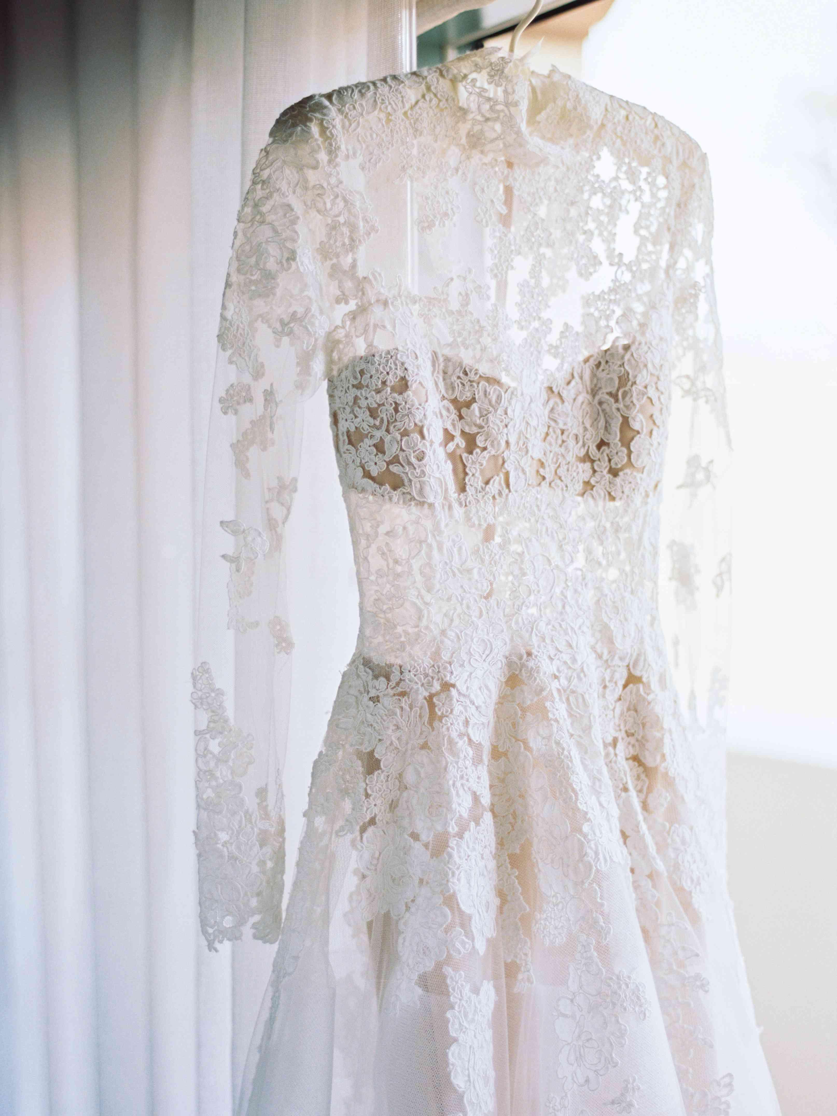 lace wedding dress hanging