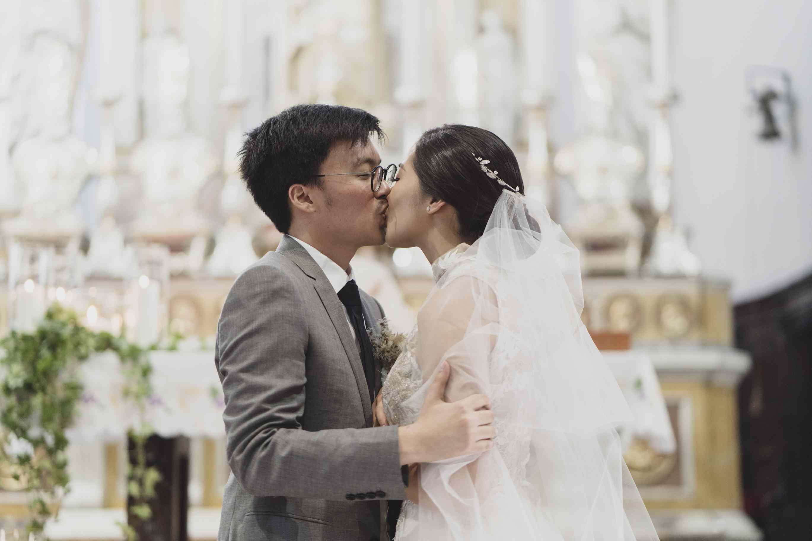 romantic lake como wedding, bride kissing groom