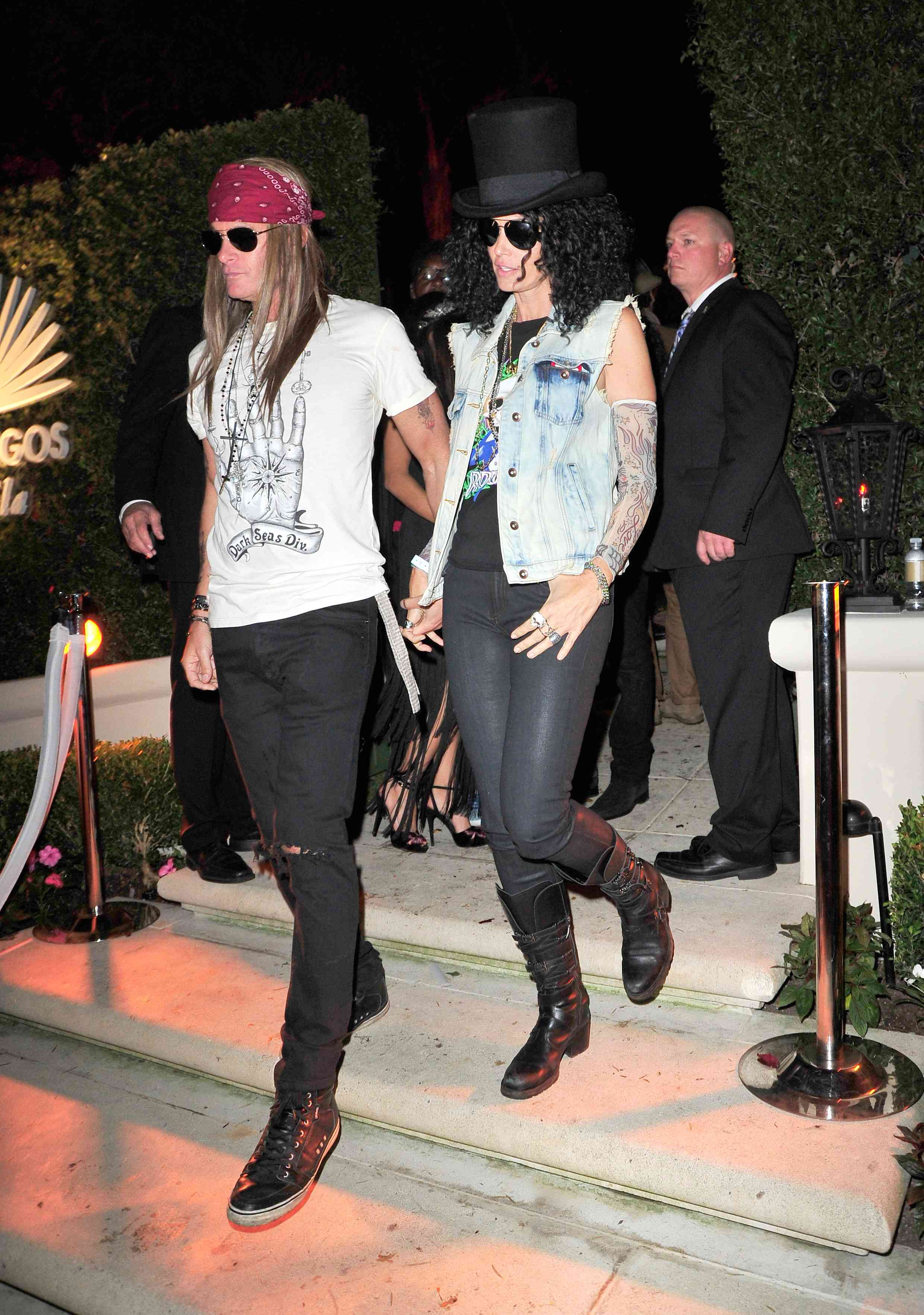 Rande Gerber and Cindy Crawford hold hands while dressed up as Axl Rose and Slash