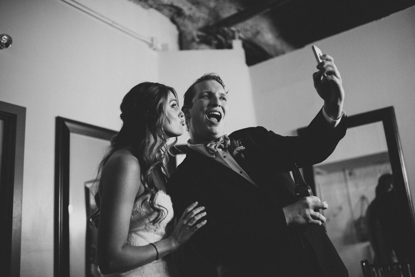 Bride and groomsman taking selfie
