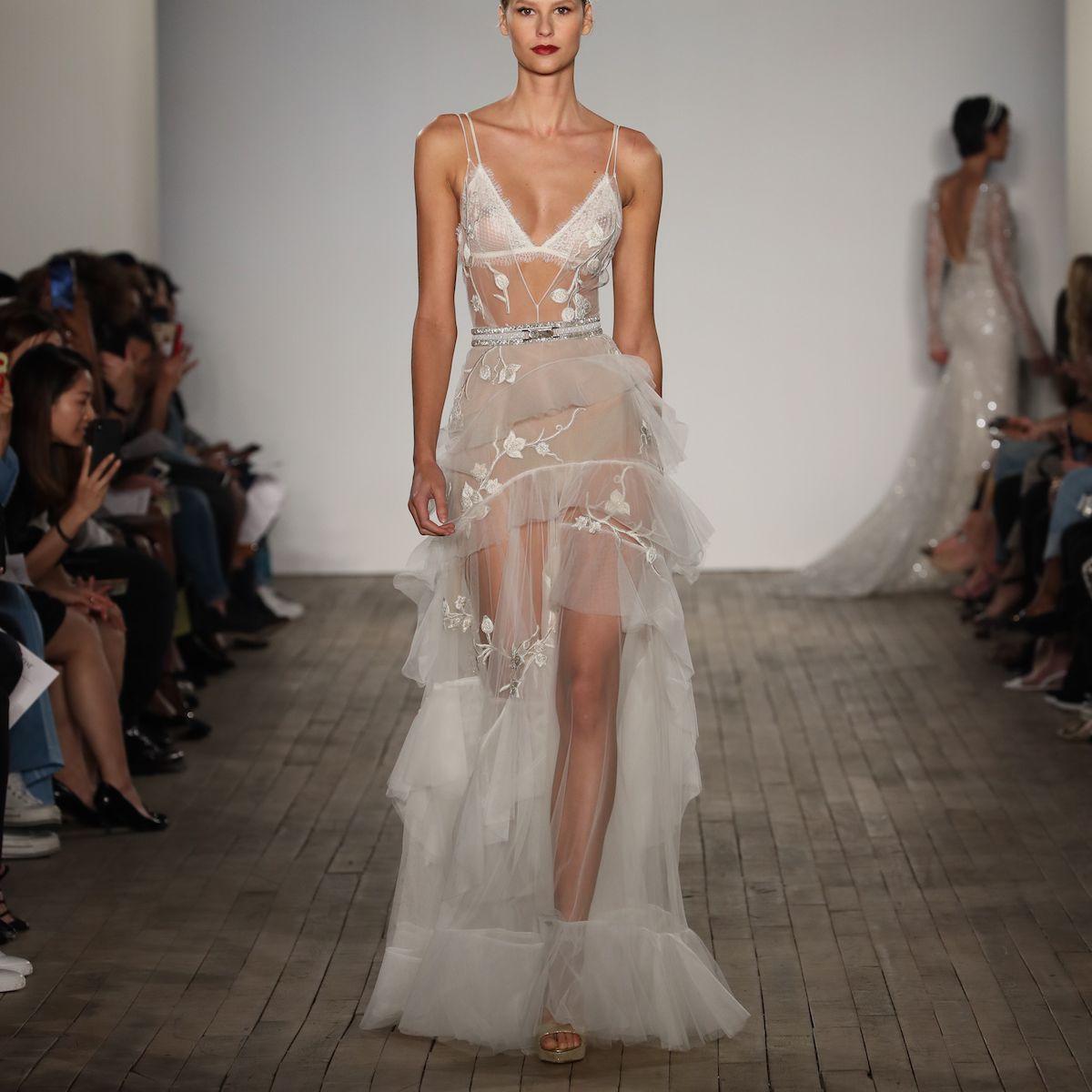 Model in sheer sleeveless wedding dress