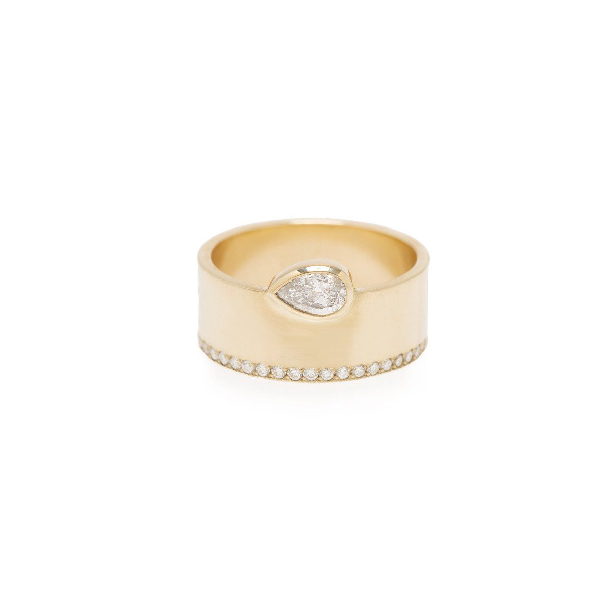 Pear diamond engagement ring with thick yellow gold band on a white background