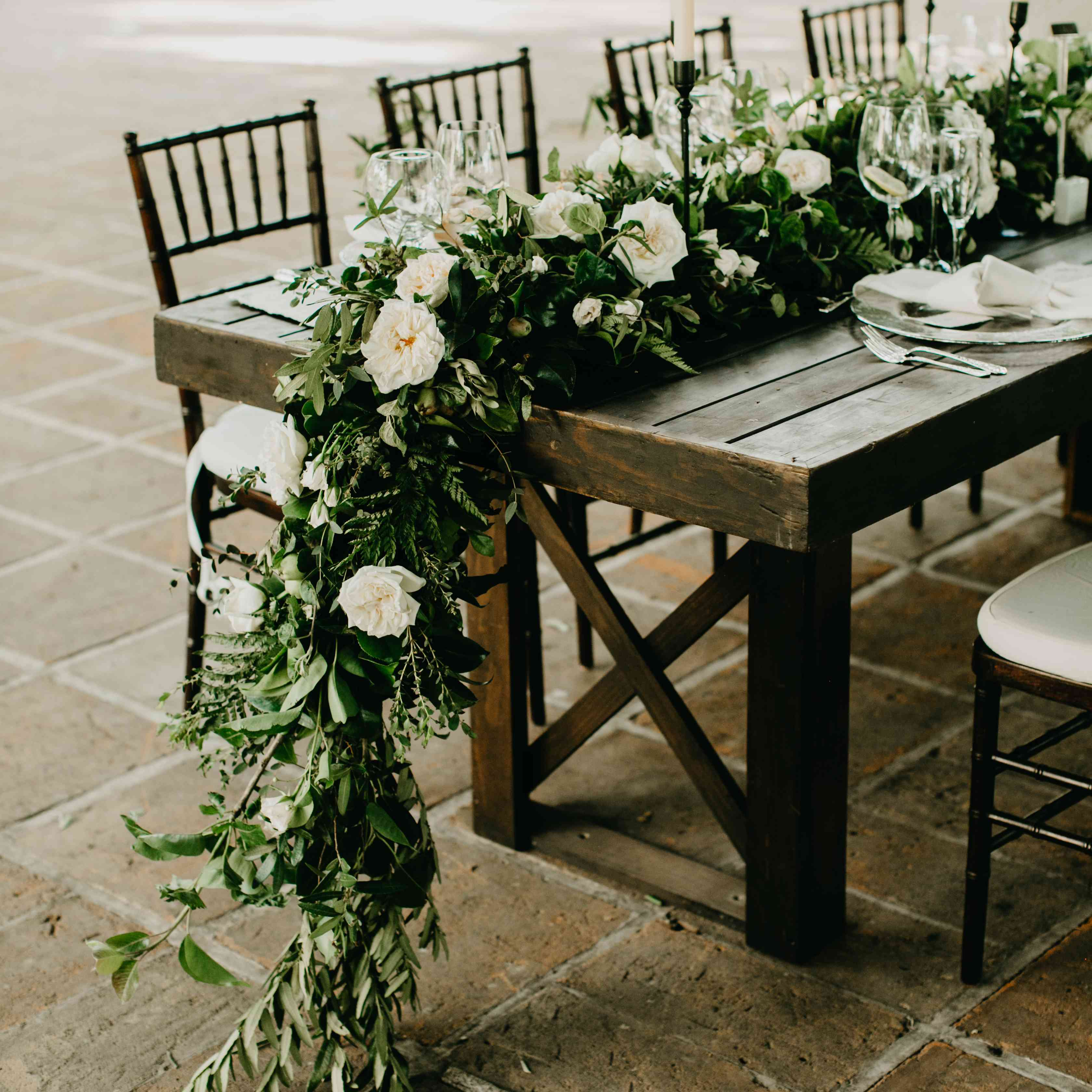 Green and white floral runner on rustic table