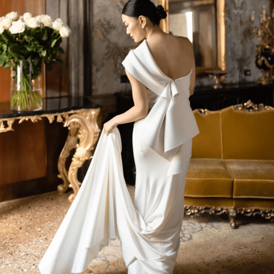 Bride showing off back of architectural gown