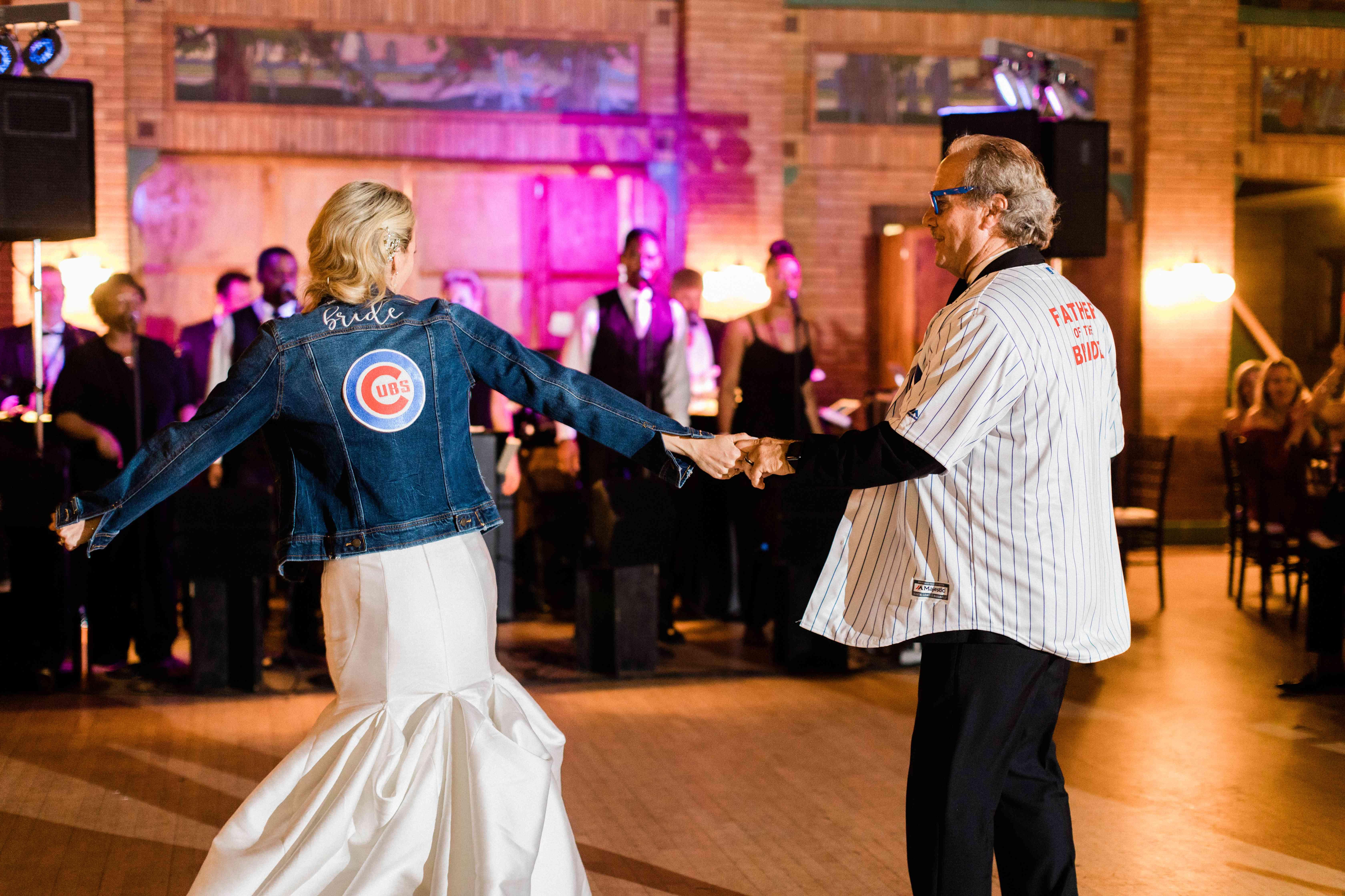 <p>Bride dancing in cubs jacket</p><br><br>