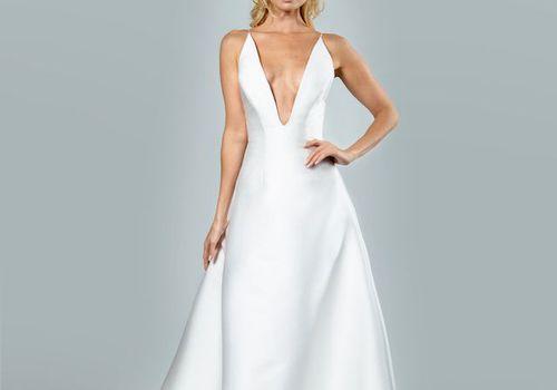 Model in deep v-cut wedding dress.