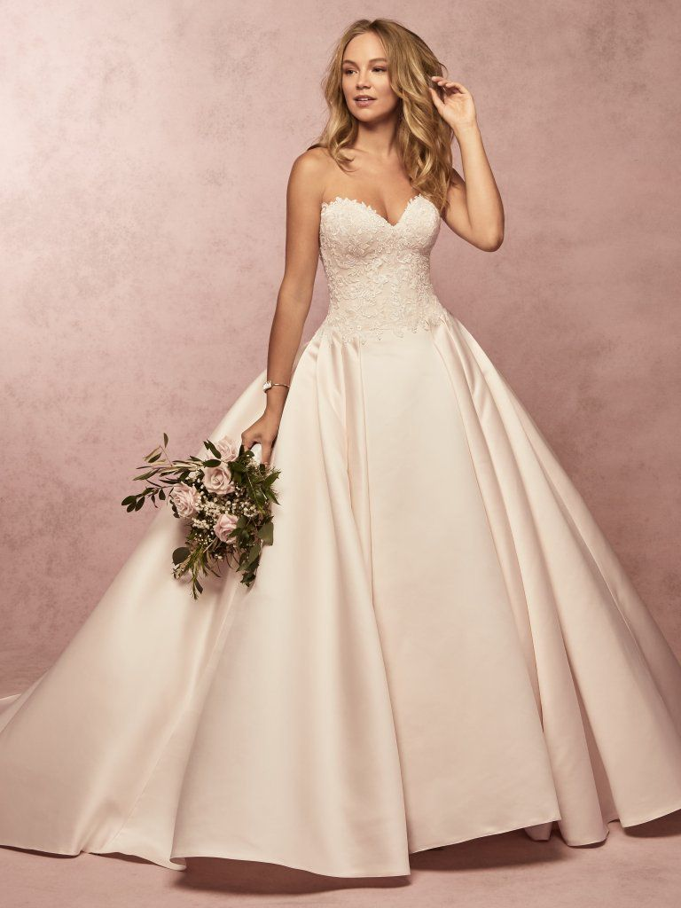 Model in strapless sweetheart bridal ball gown
