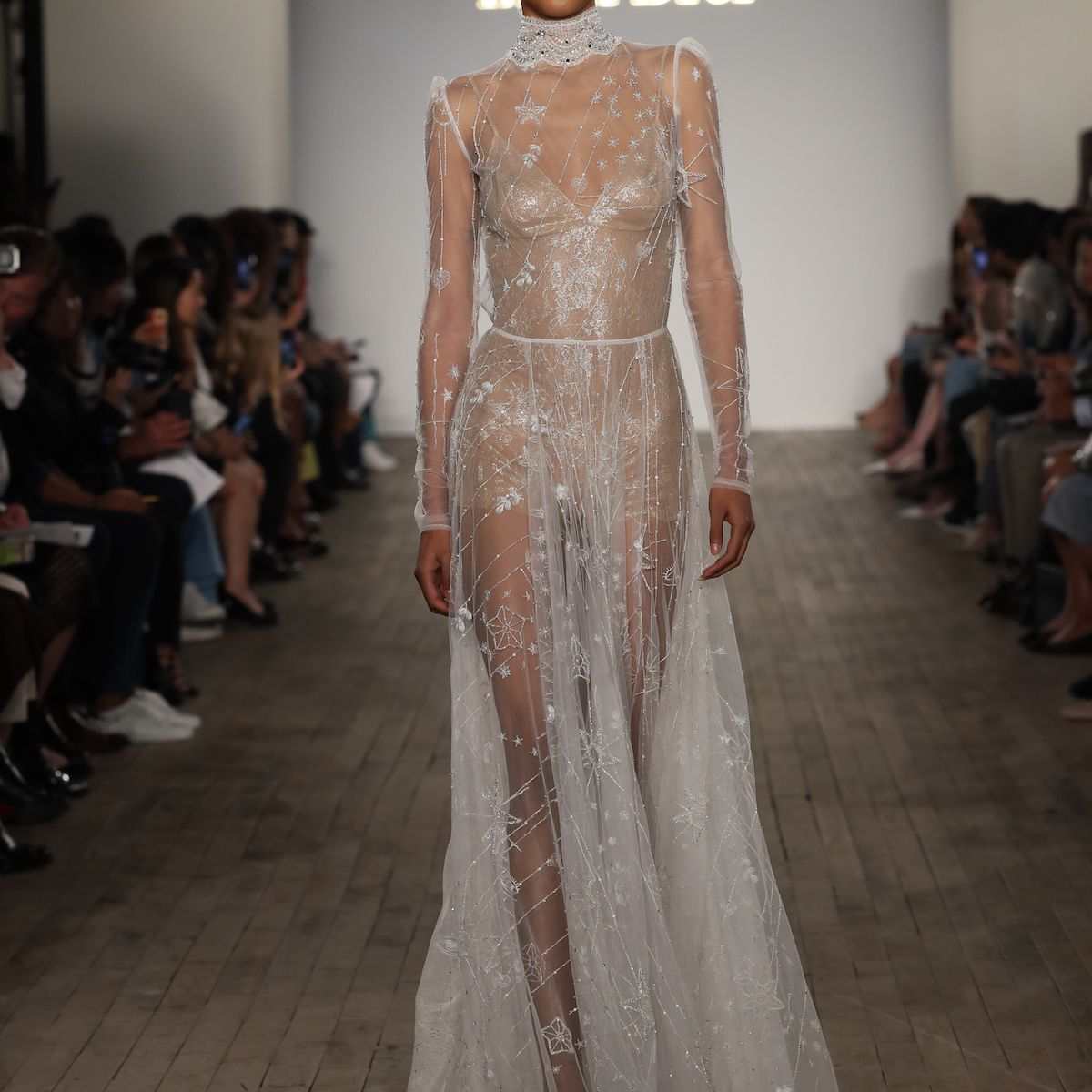 Model in long sleeve high-neck wedding dress