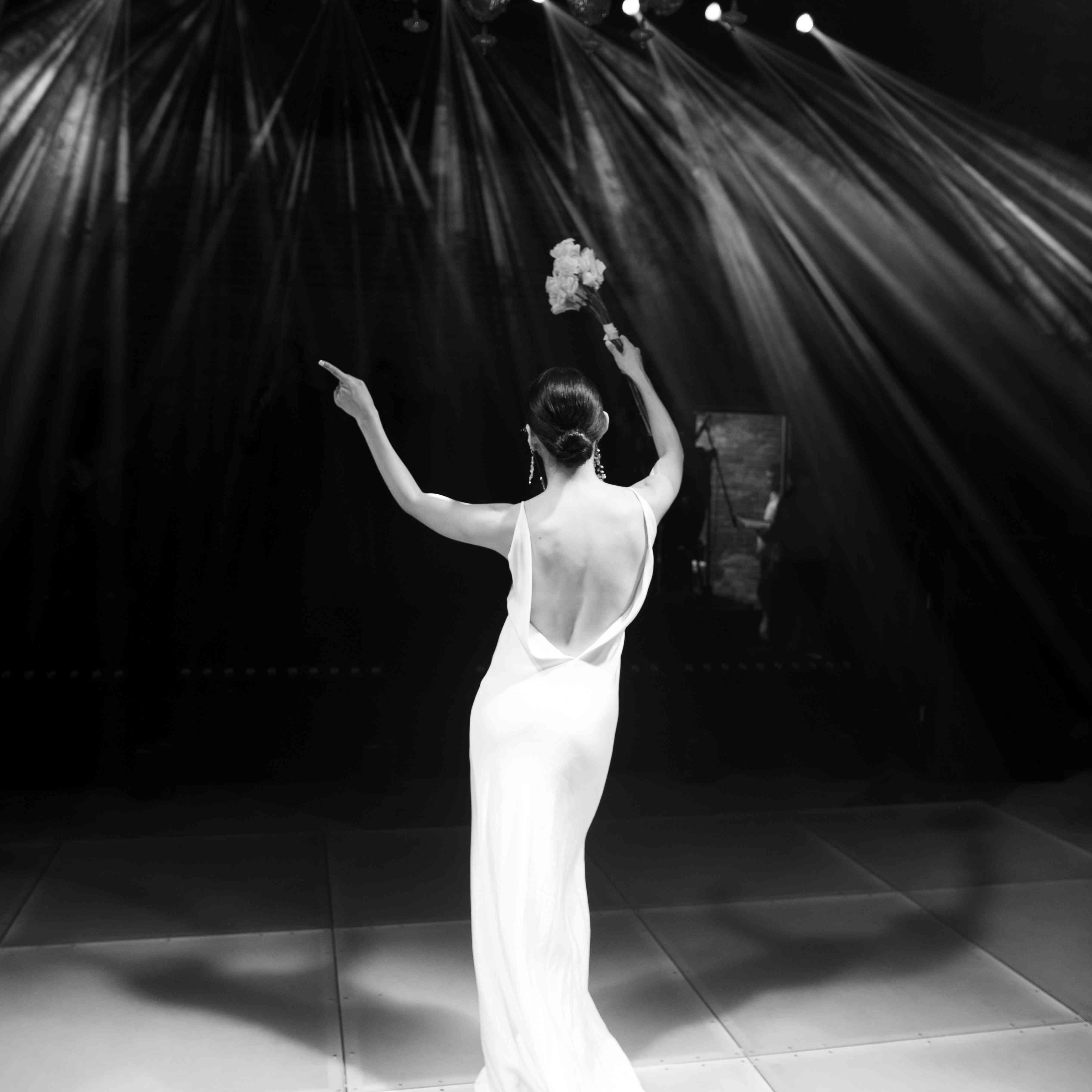 modern venice wedding, bride dancing reception