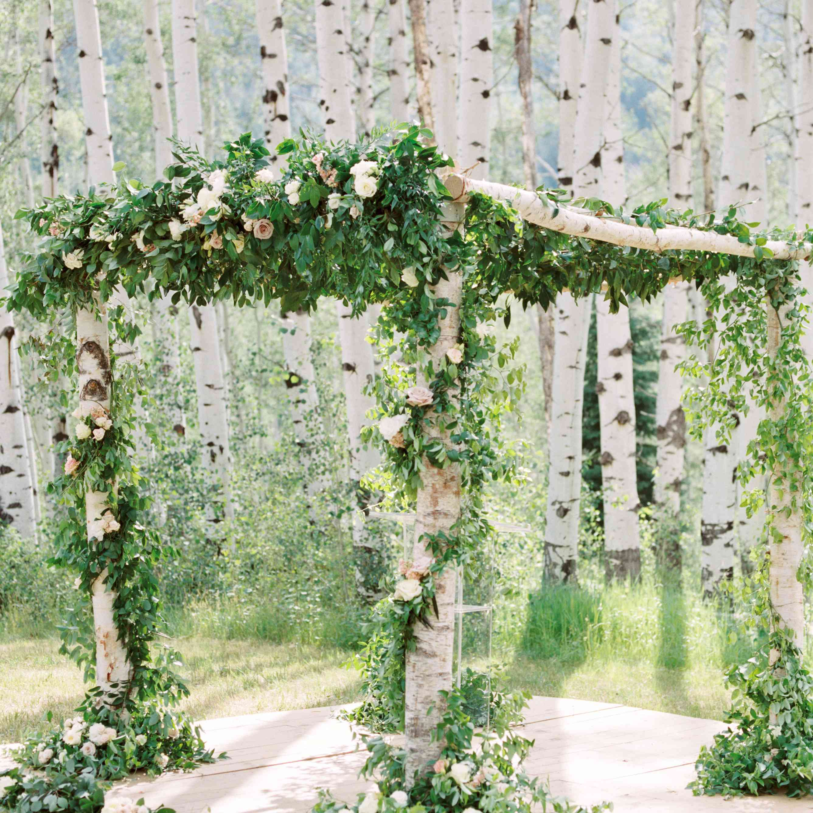 Florally decorate chuppah