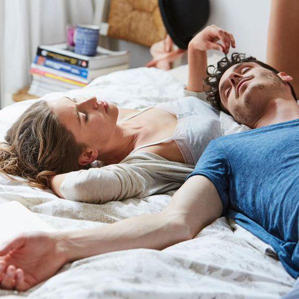 Couple lying on bed.