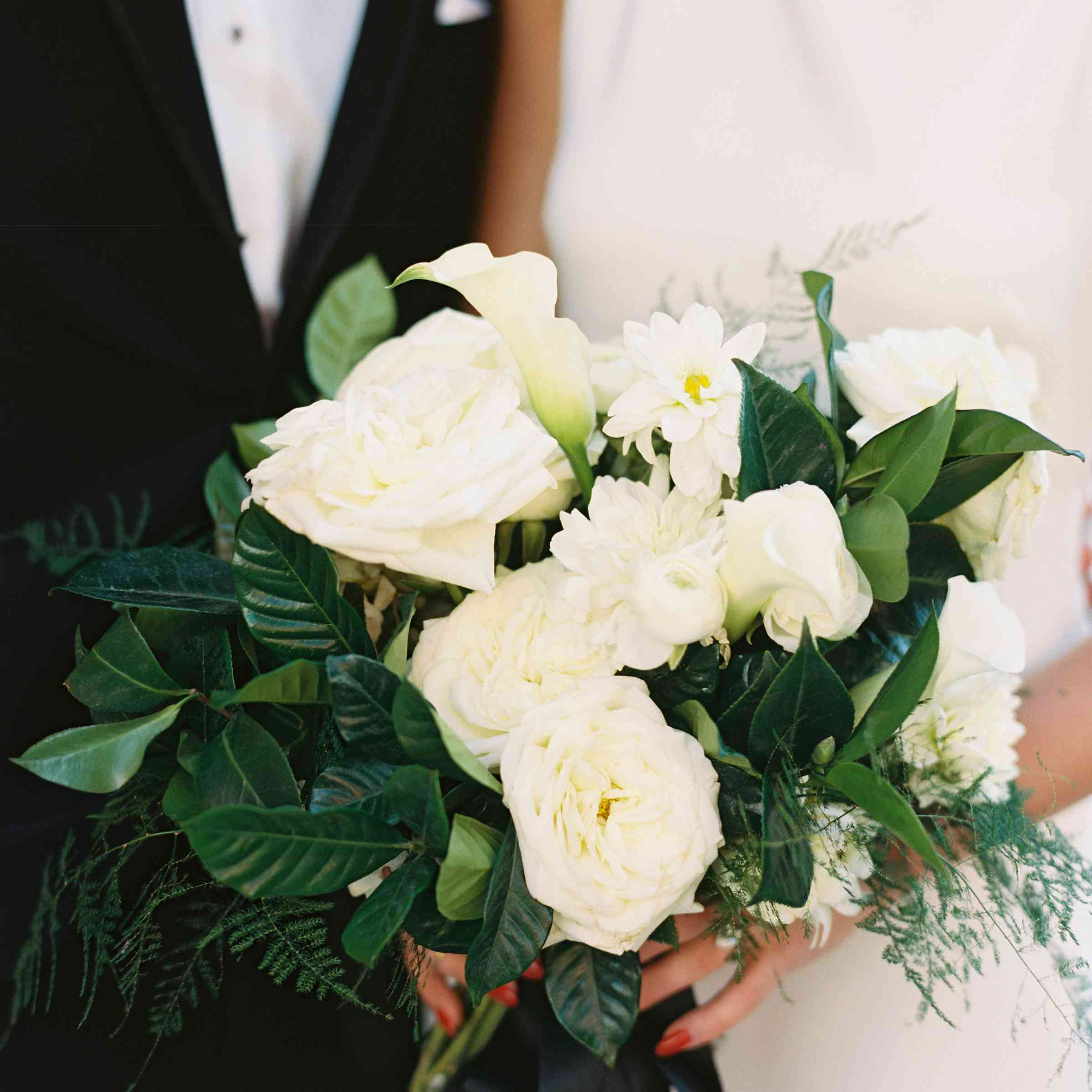 Bride and groom holding bouquet