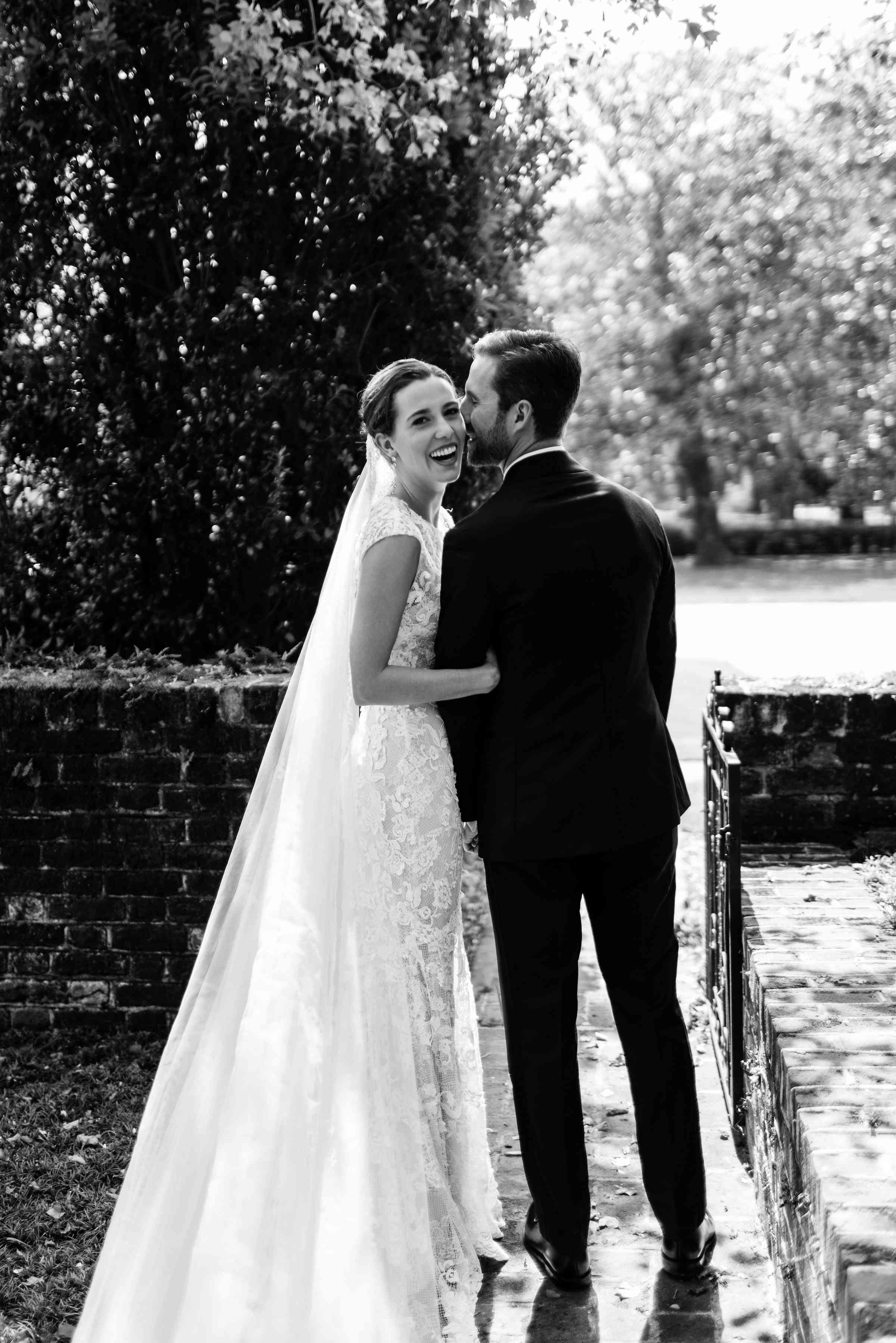 <p>Groom kissing bride black and white</p><br><br>