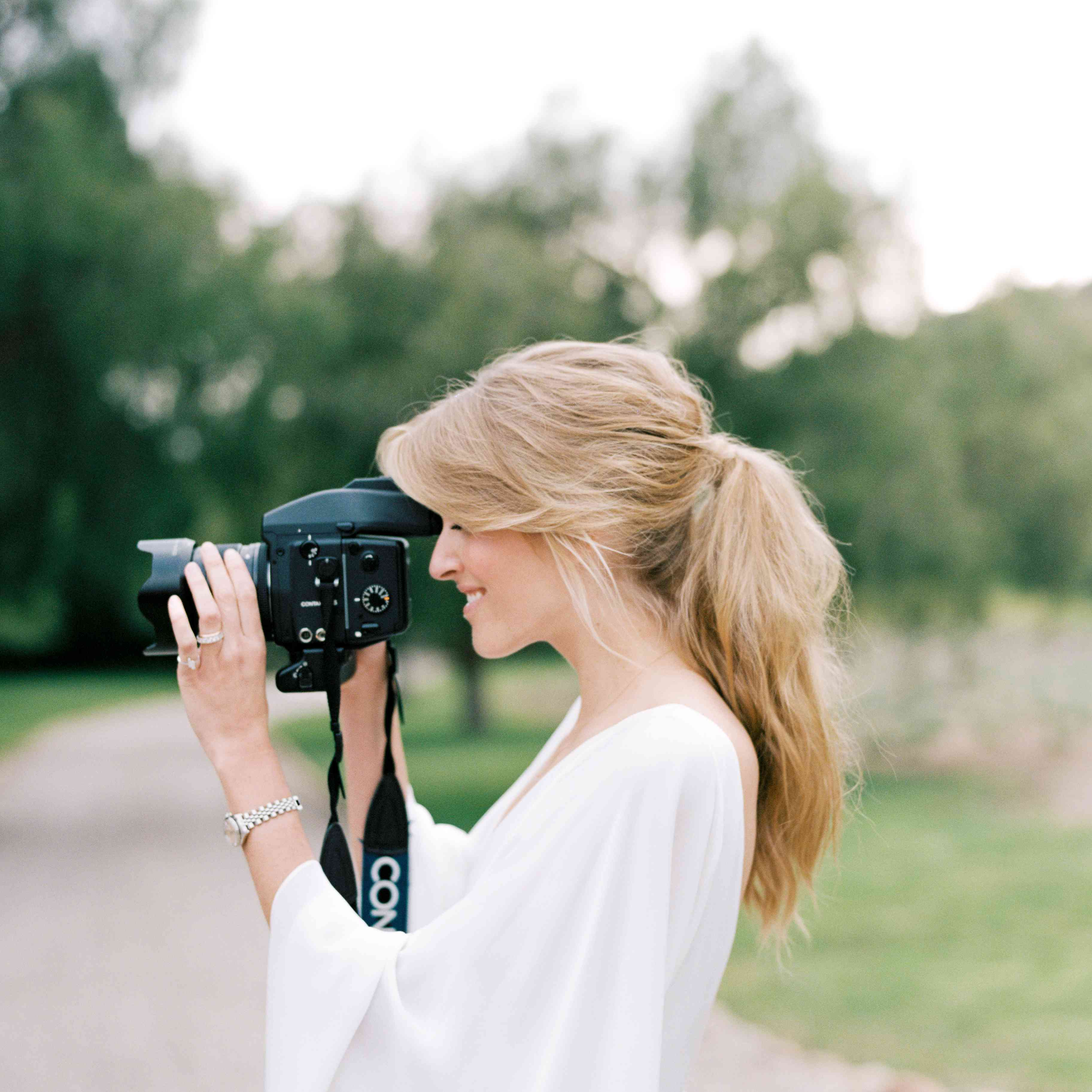 bride taking photos with camera