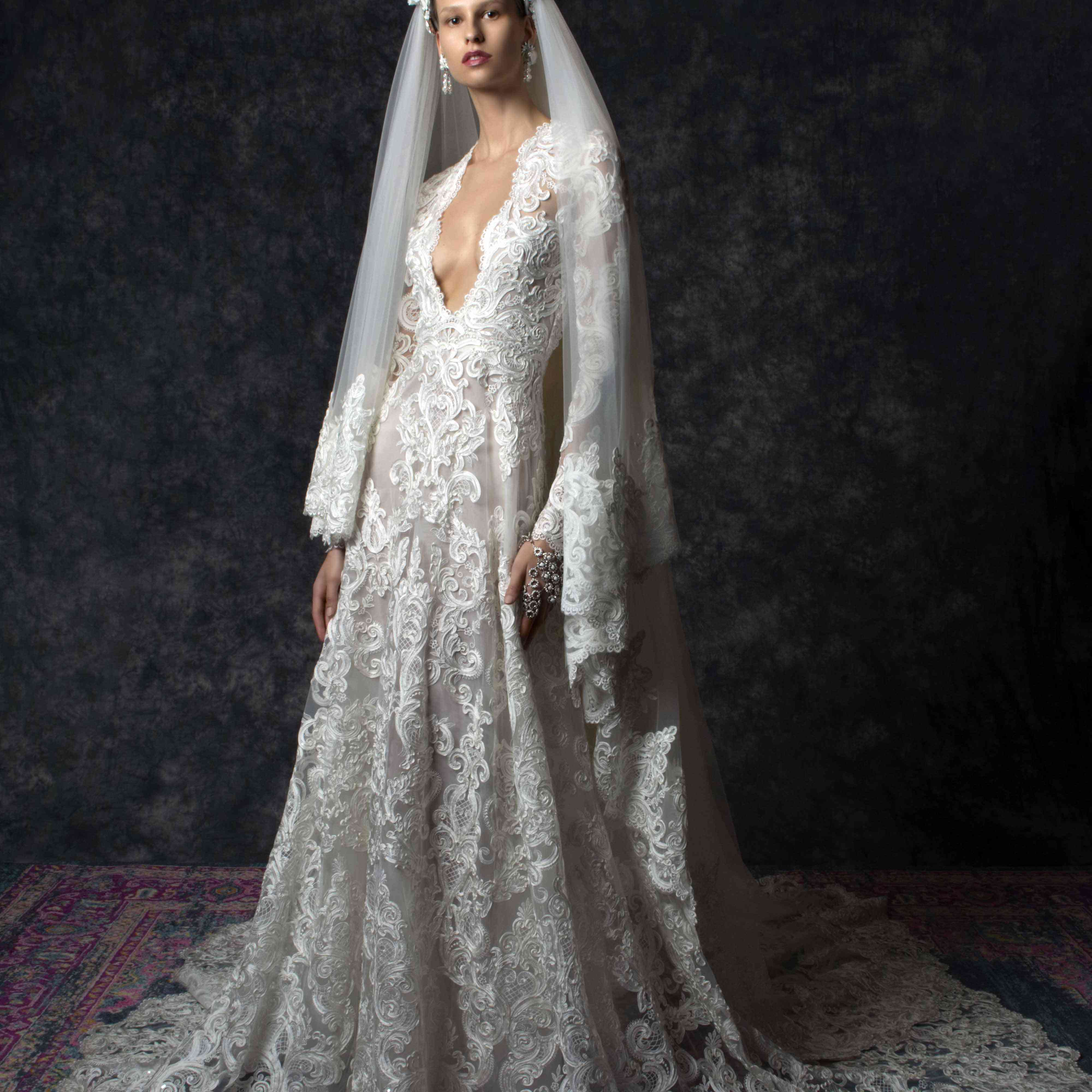 Model in long-sleeve floral gown with plunging neckline